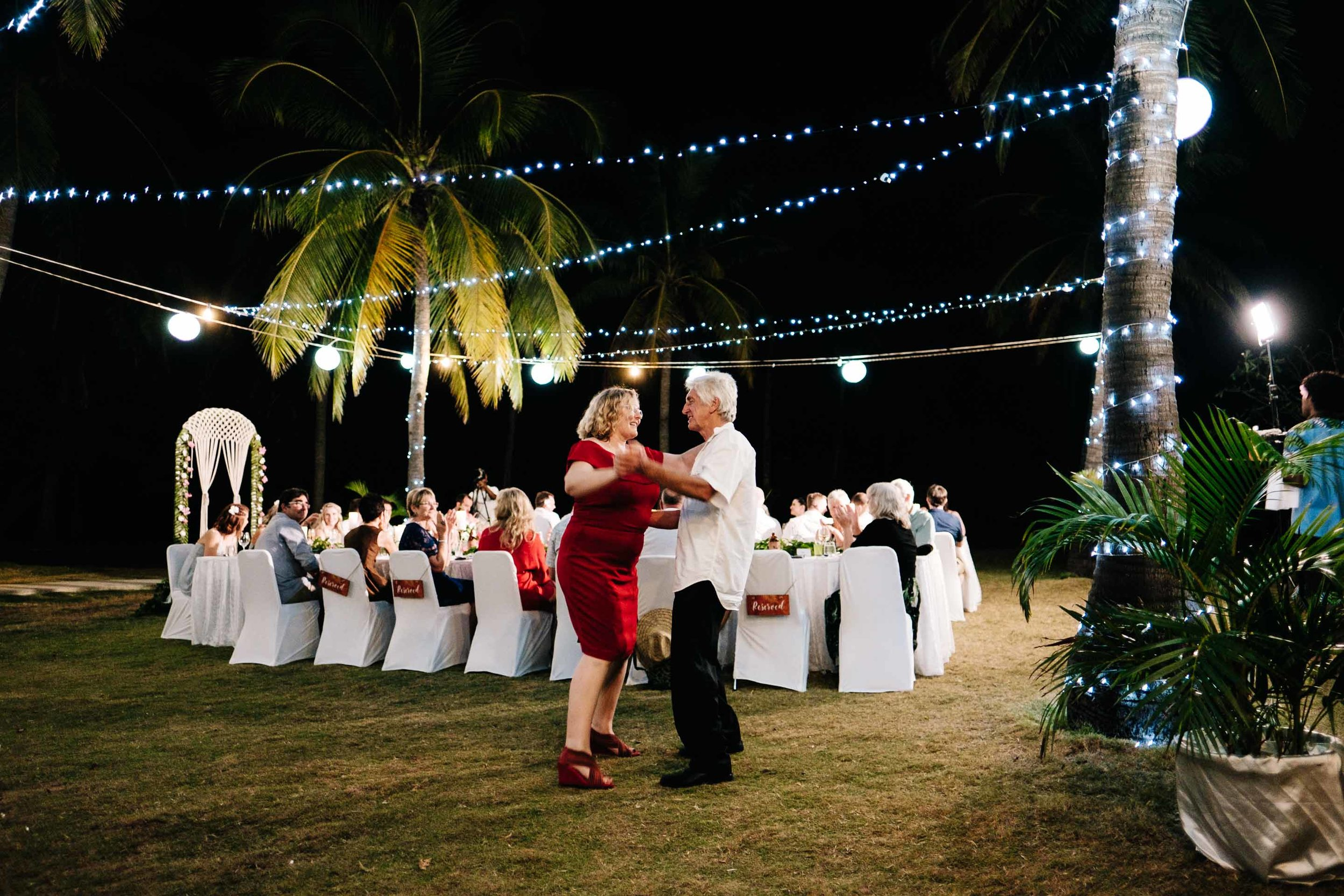 guests dancing at the outdoor reception under the stars and fairy lights