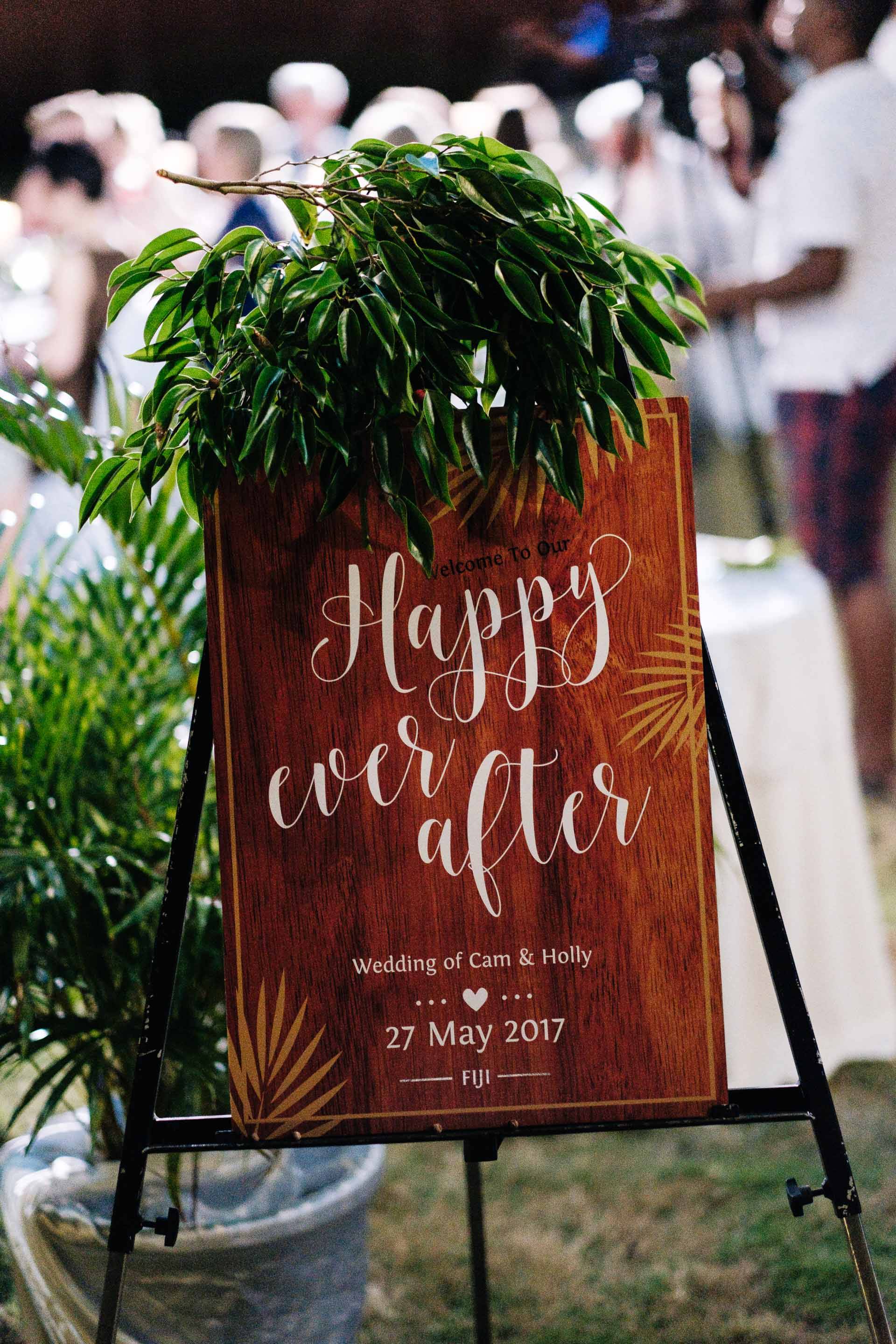 """a cutom sign board for the reception venue with the words """"happy ever after"""" printed on it"""