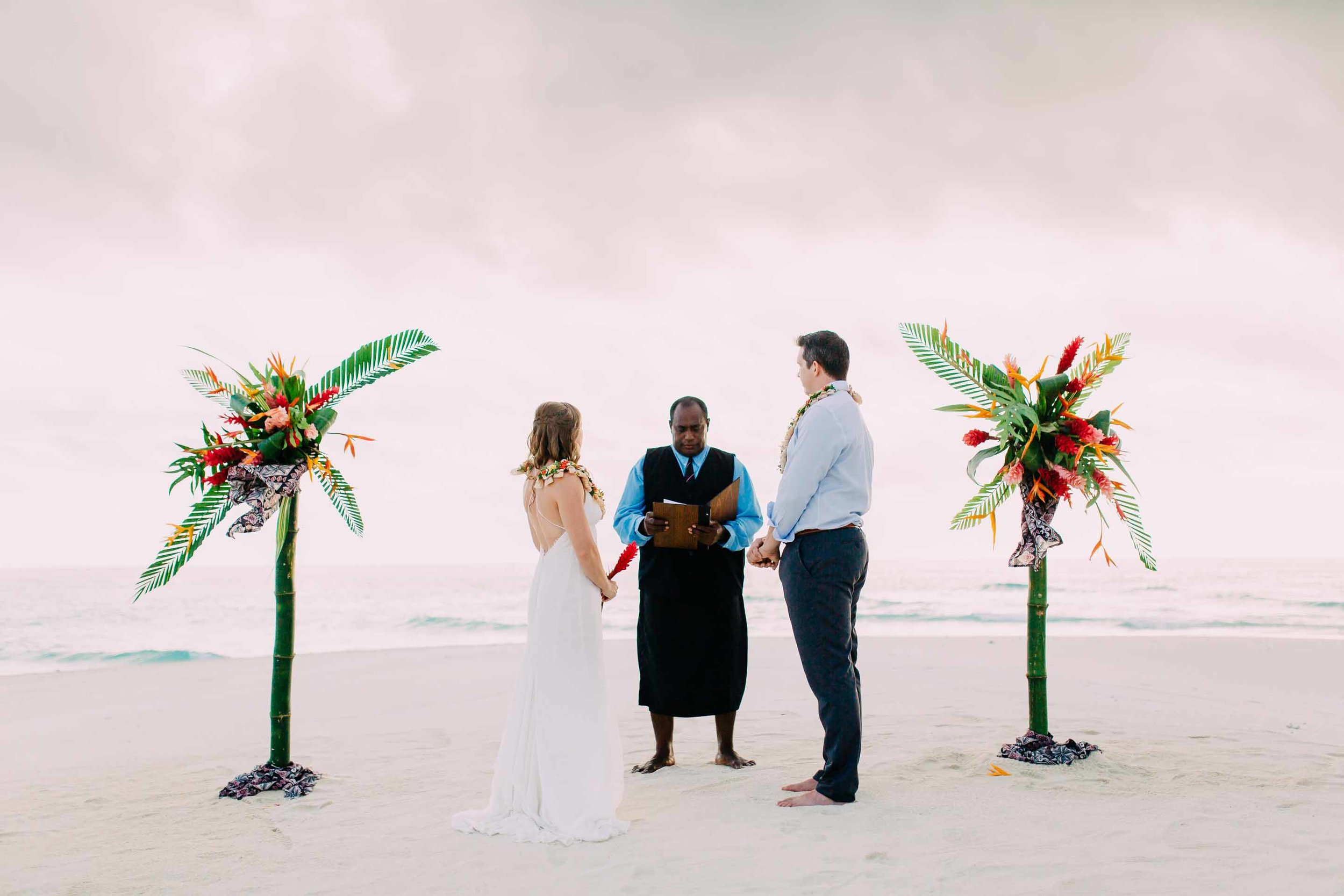 Celebrant performs the ceremony for the excited couple