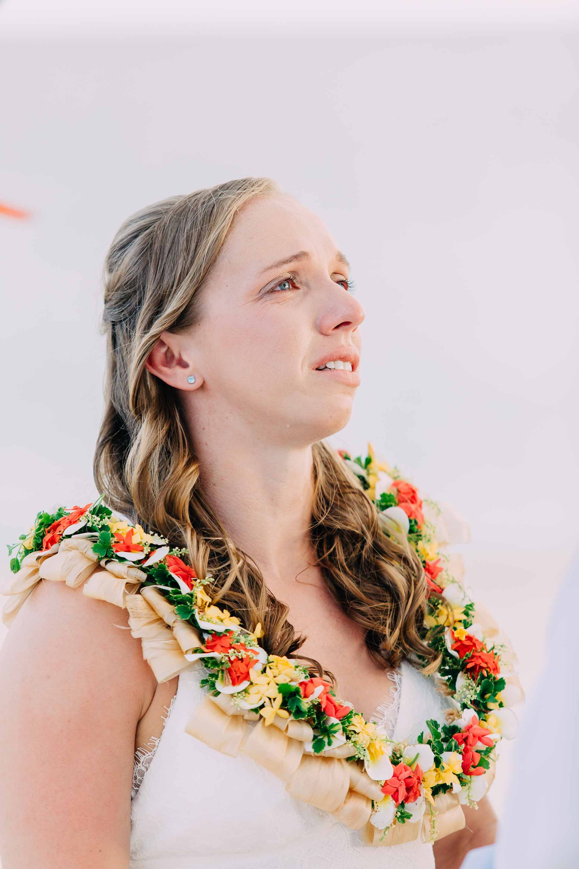 An emotional bride says her vows during her Fiji sand quay wedding