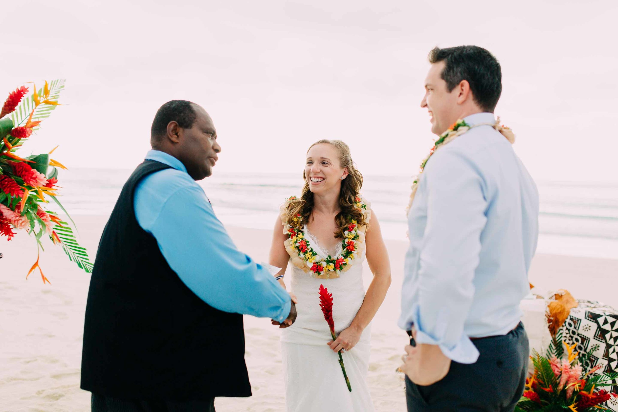 Happy couple shake hands with their marriage celebrant. Happy to be married in Fiji.