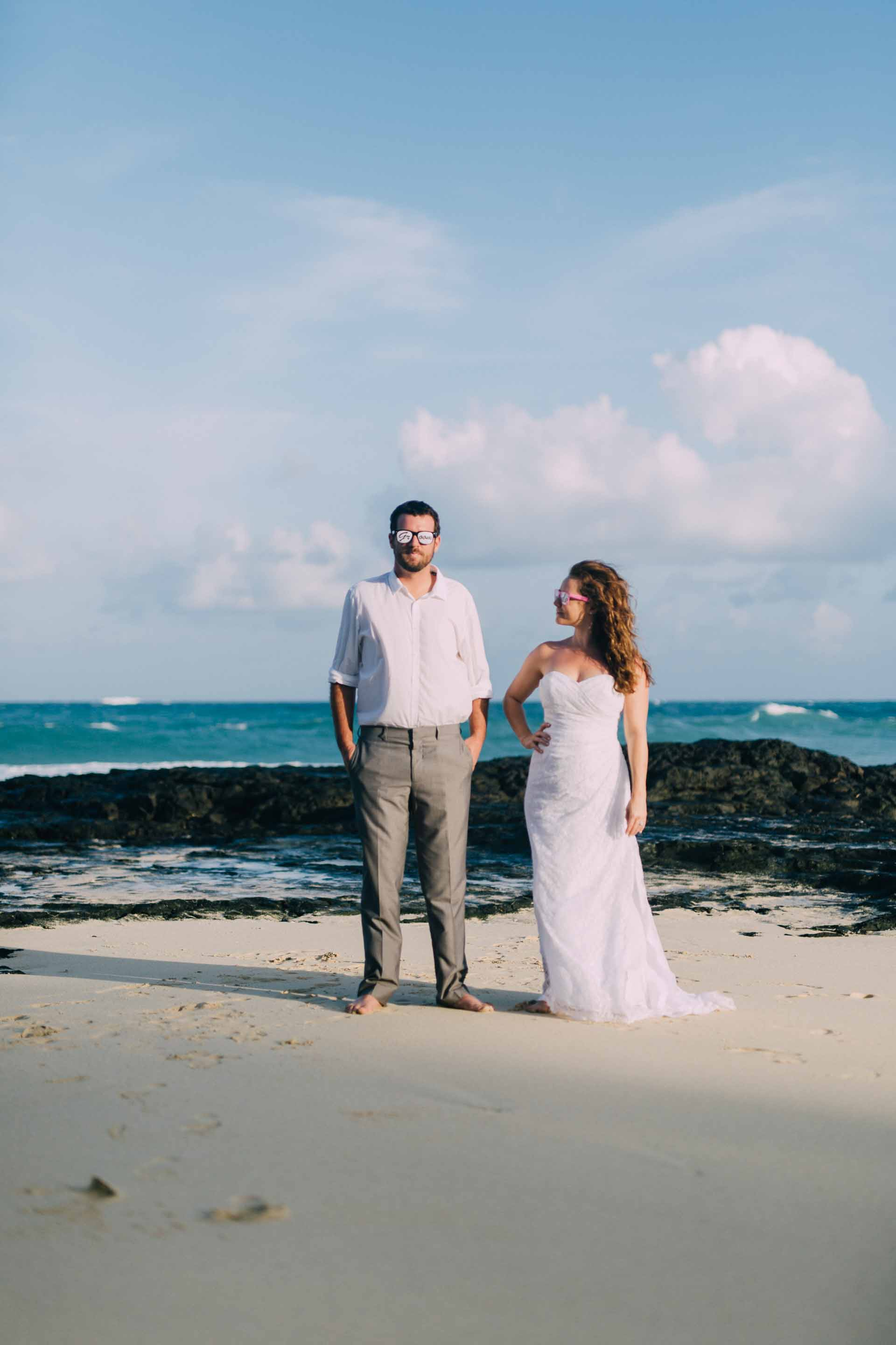 Newlyweds on the beach in Fiji for their trash the dress session the day after the wedding.