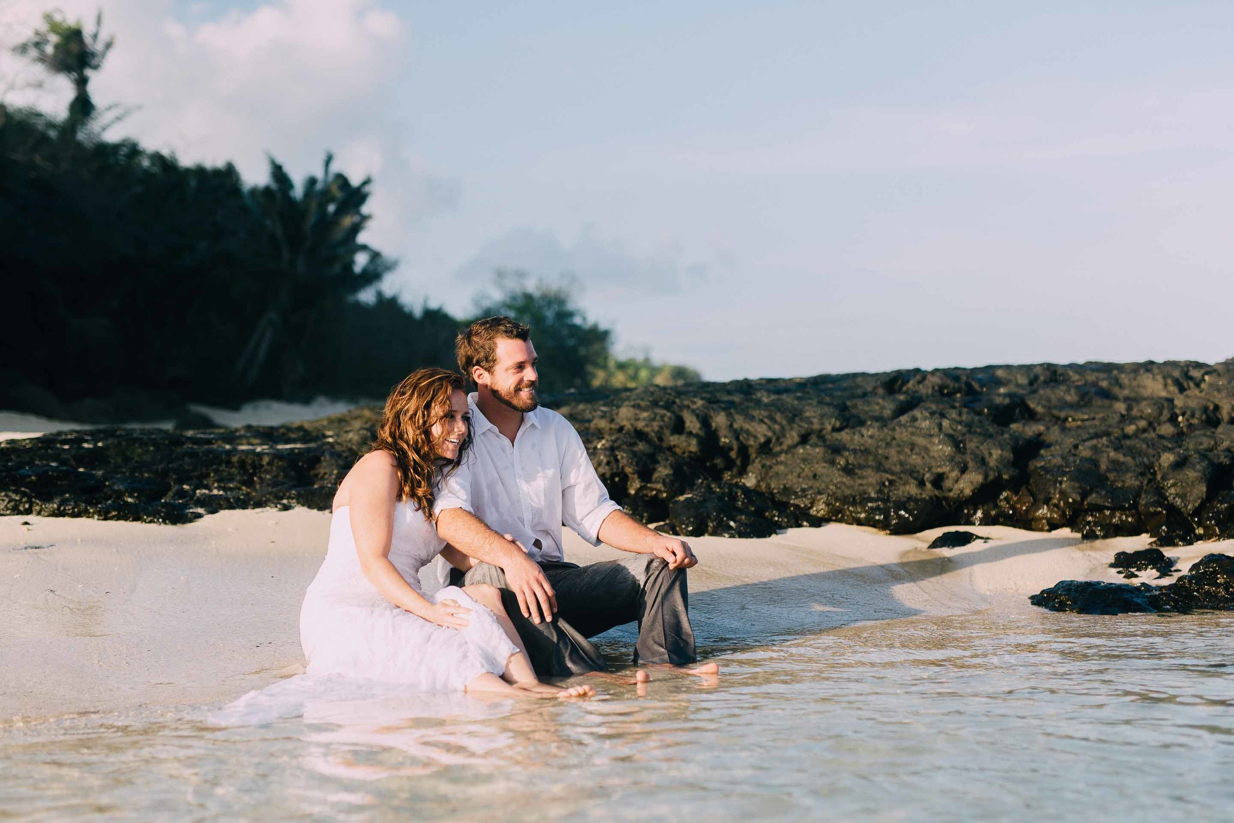 Newlywed couple on the beach in Fiji for their trash the dress session.