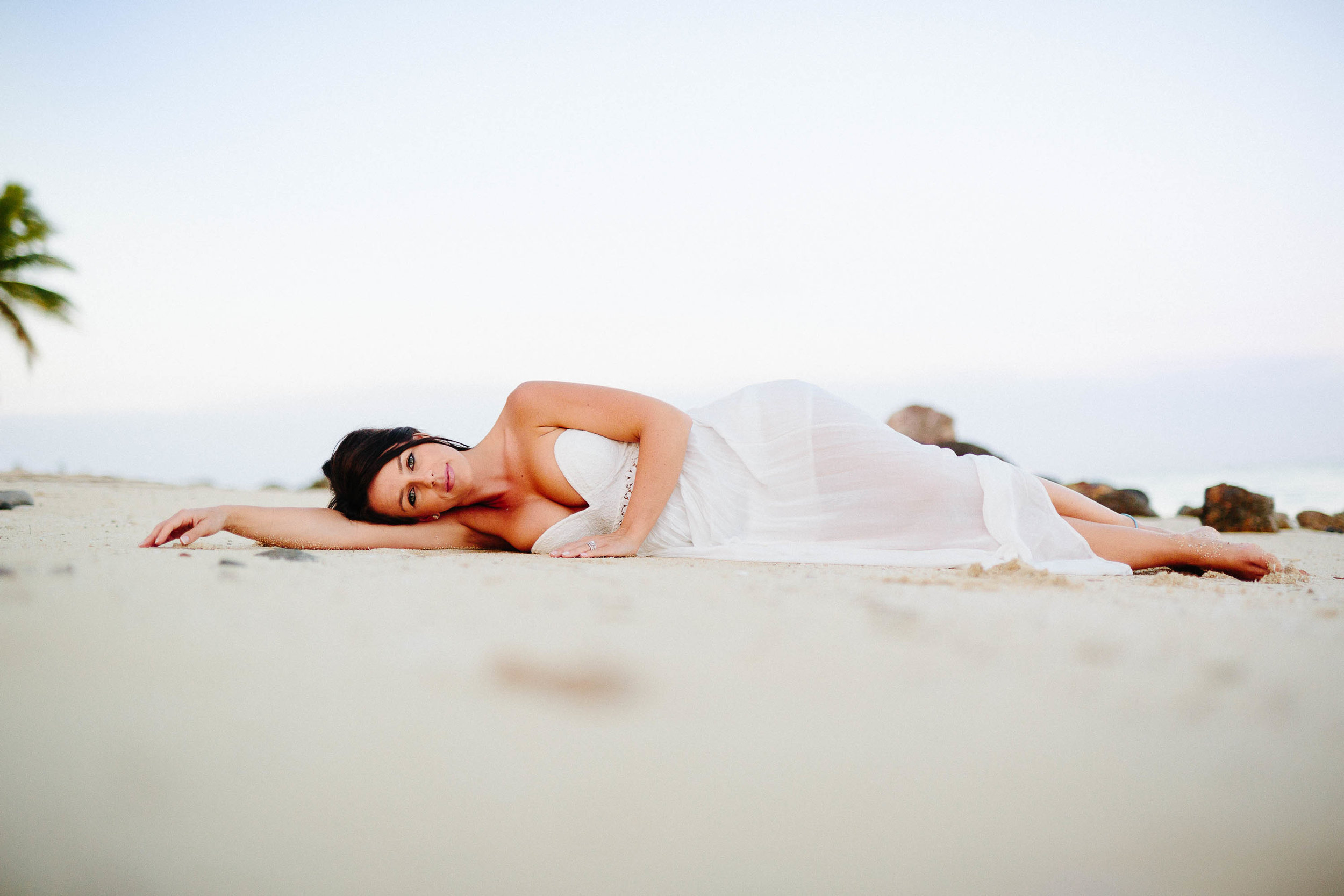 bride laying on beach