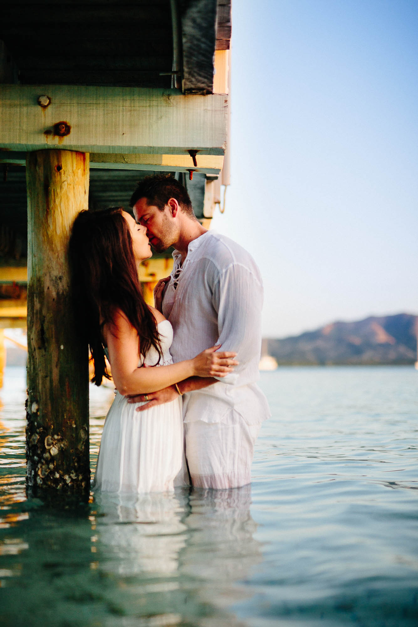 Couple kissing under the pier