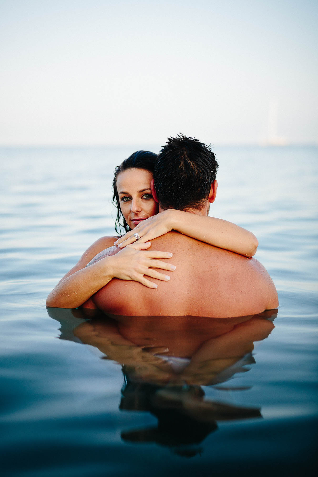 Bride and groom hugging in the sea