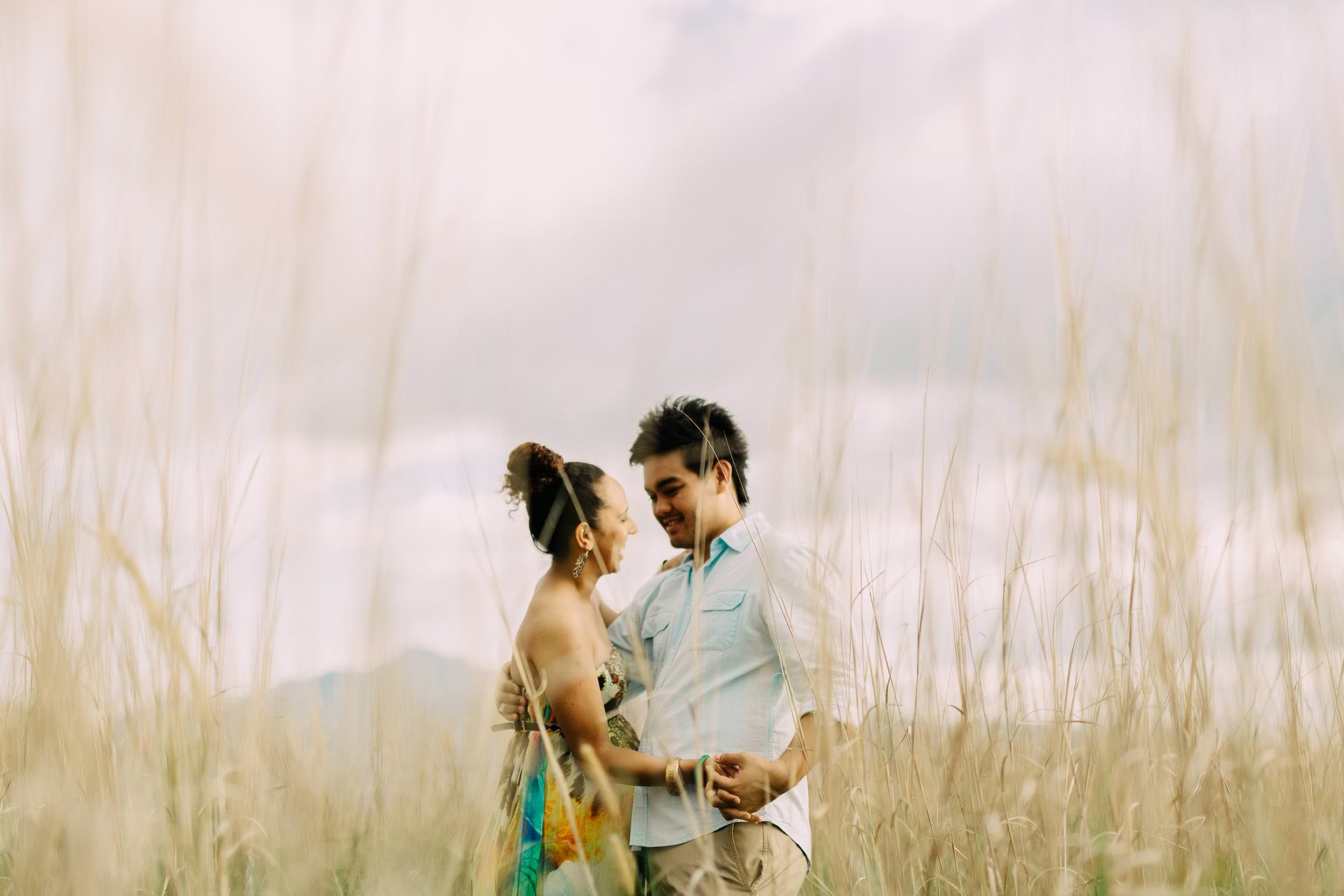 the couple sharing a light moment during their engagement session