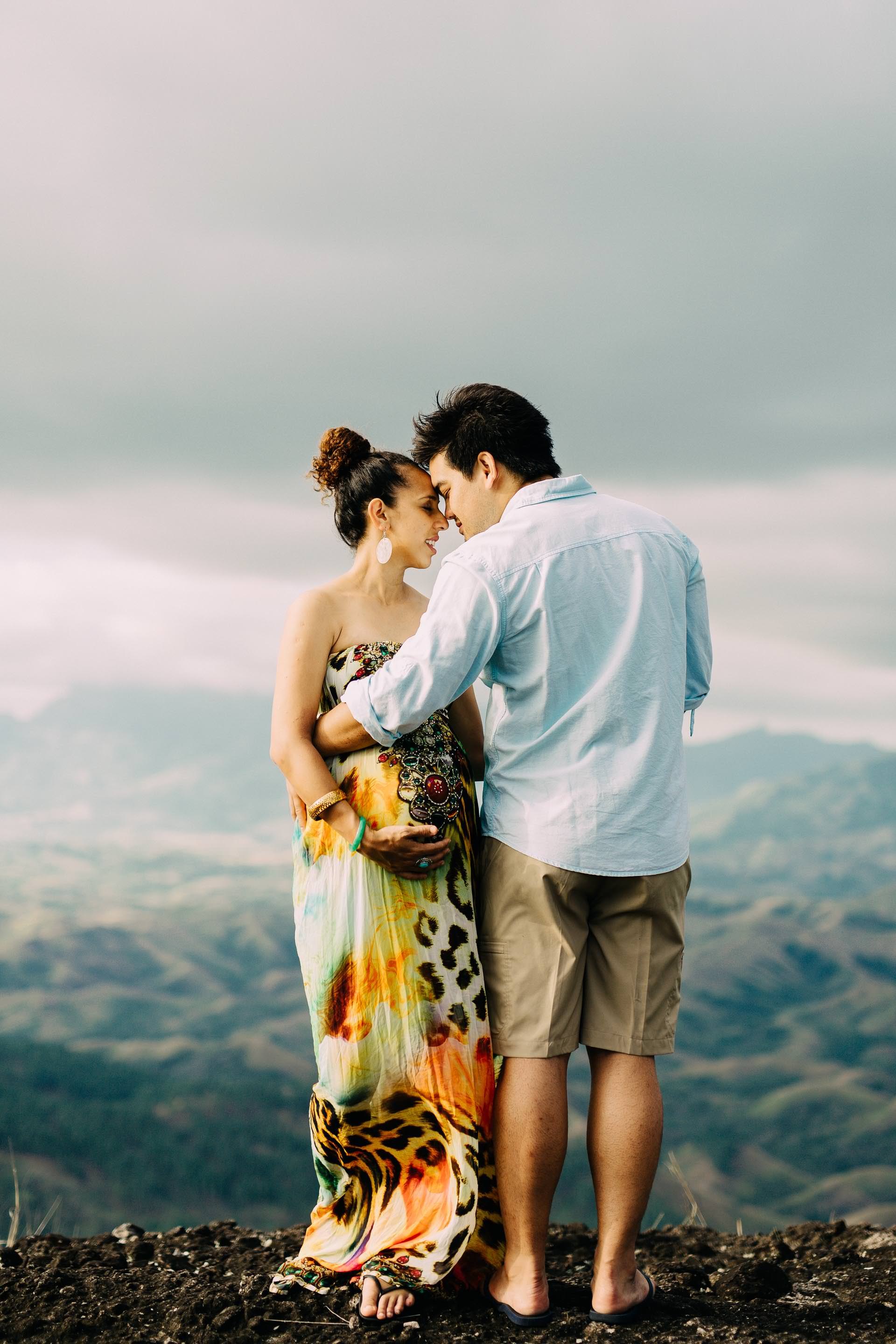 a touching moment during the engagement session