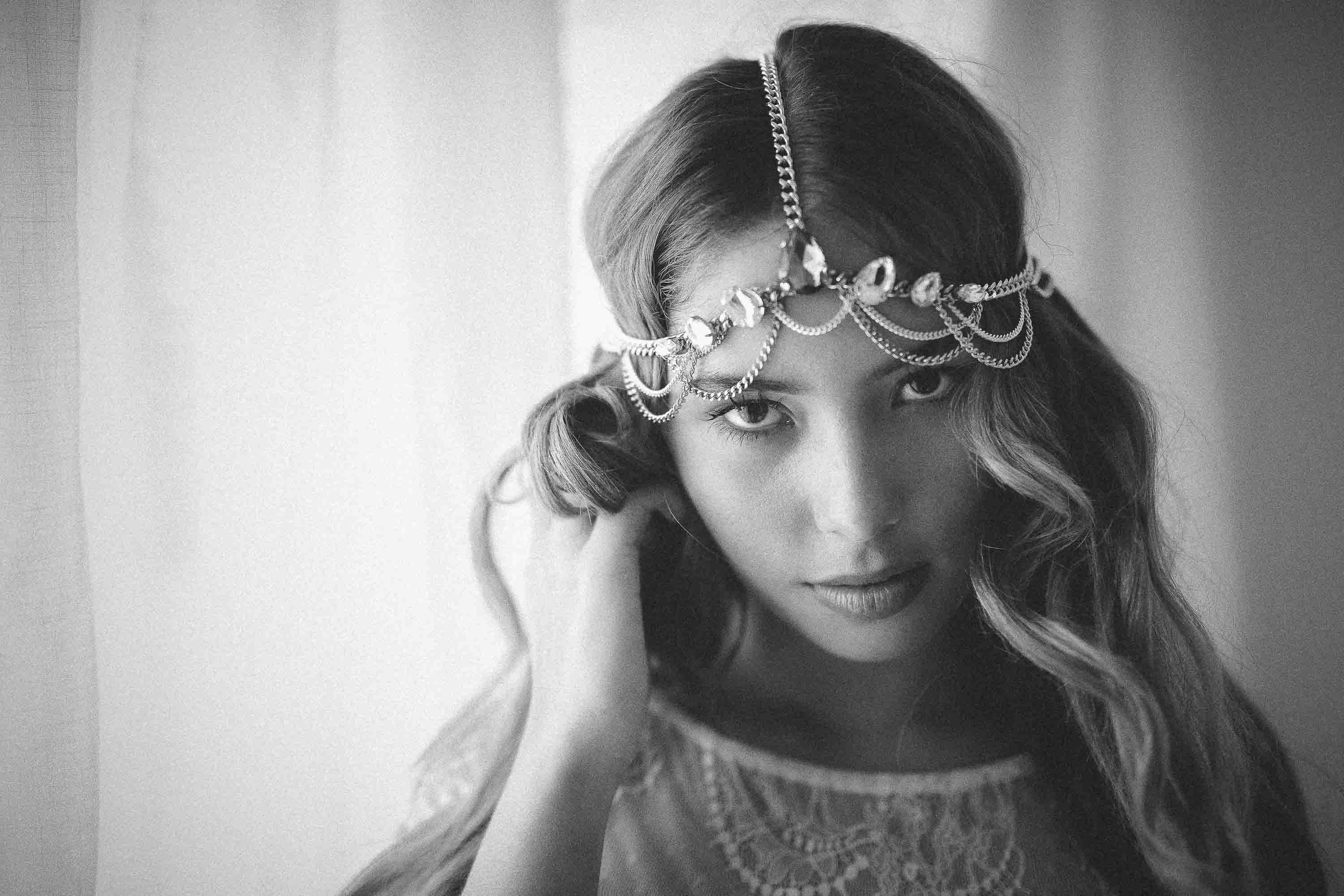 model with silver headpiece in hotel suite
