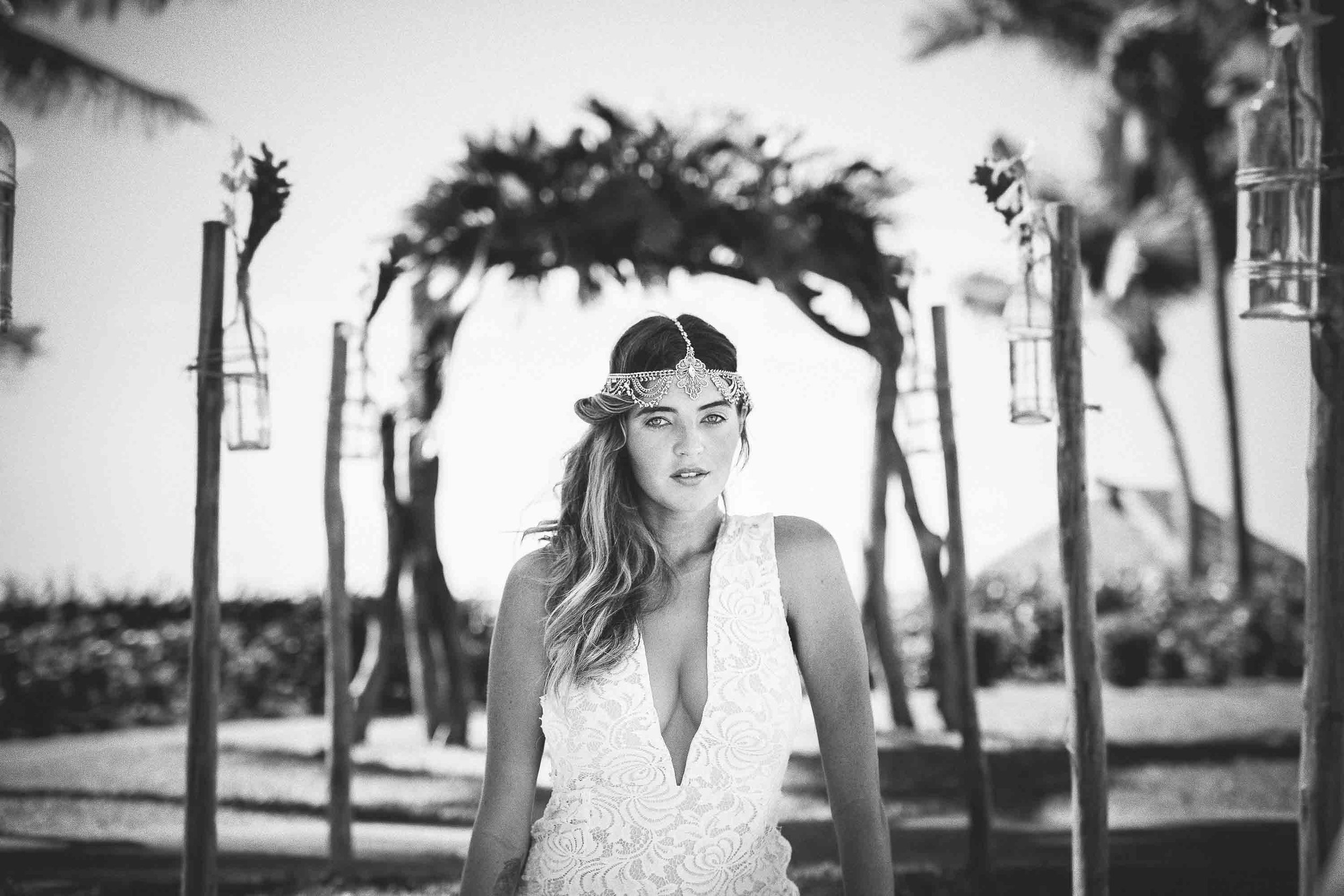 model with silver headpiece at a outdoor wedding setup