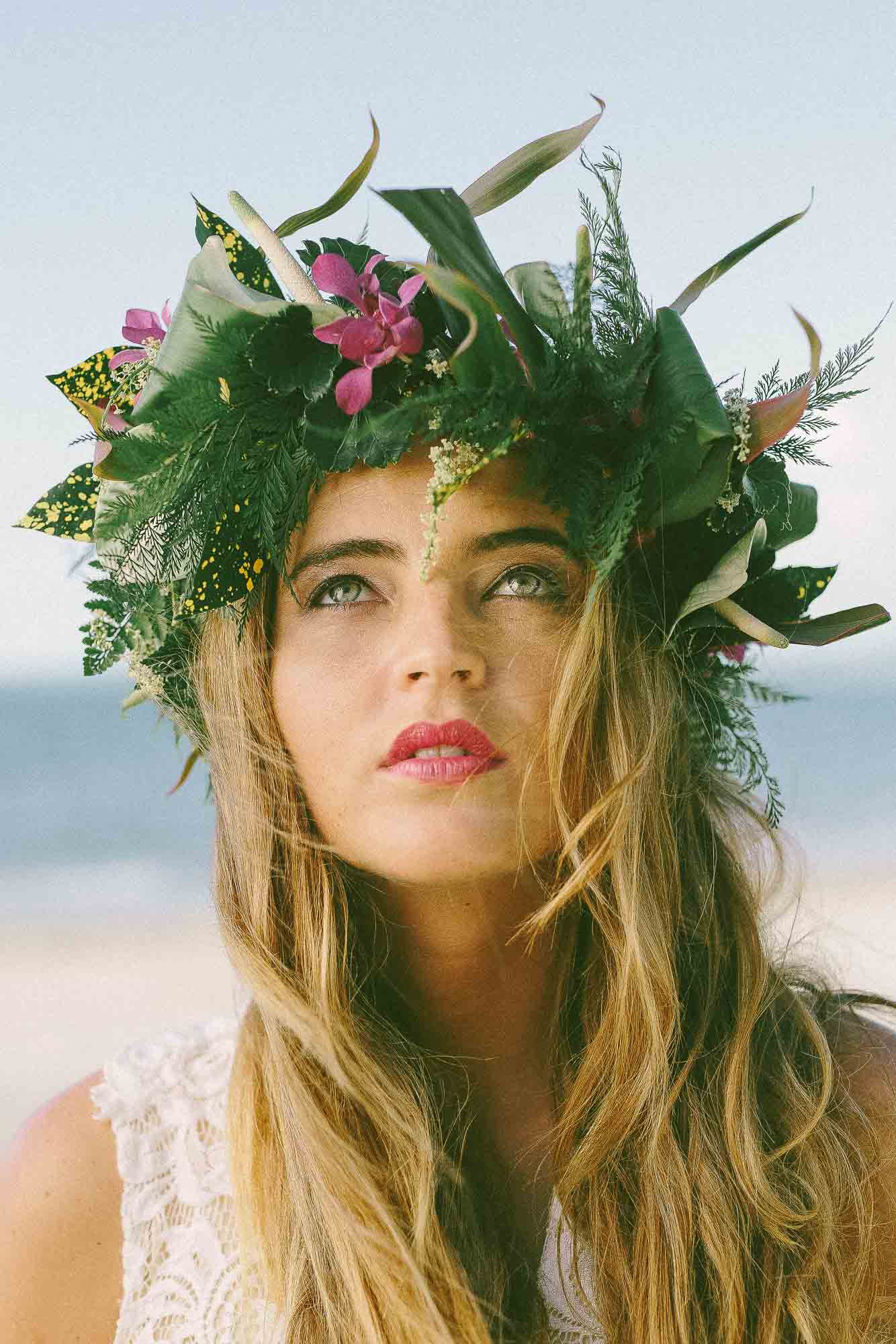 Model with floral headpiece on beach