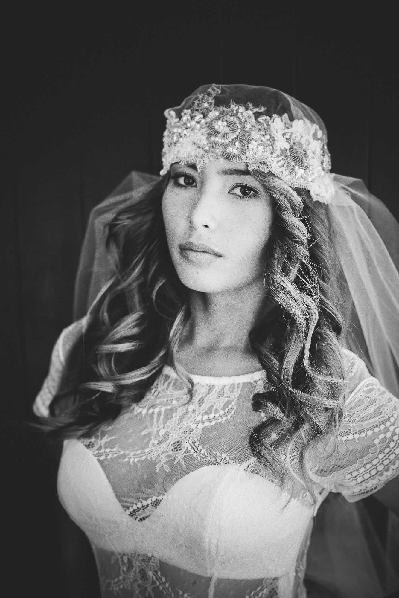 model with veil posing infront of chapel door