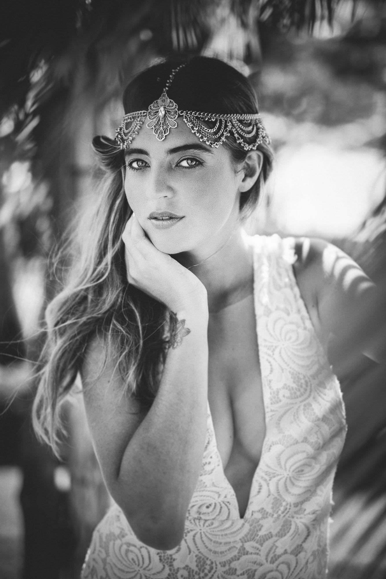 model posing under driftwood arch wearing Frankly My Dear headpiece