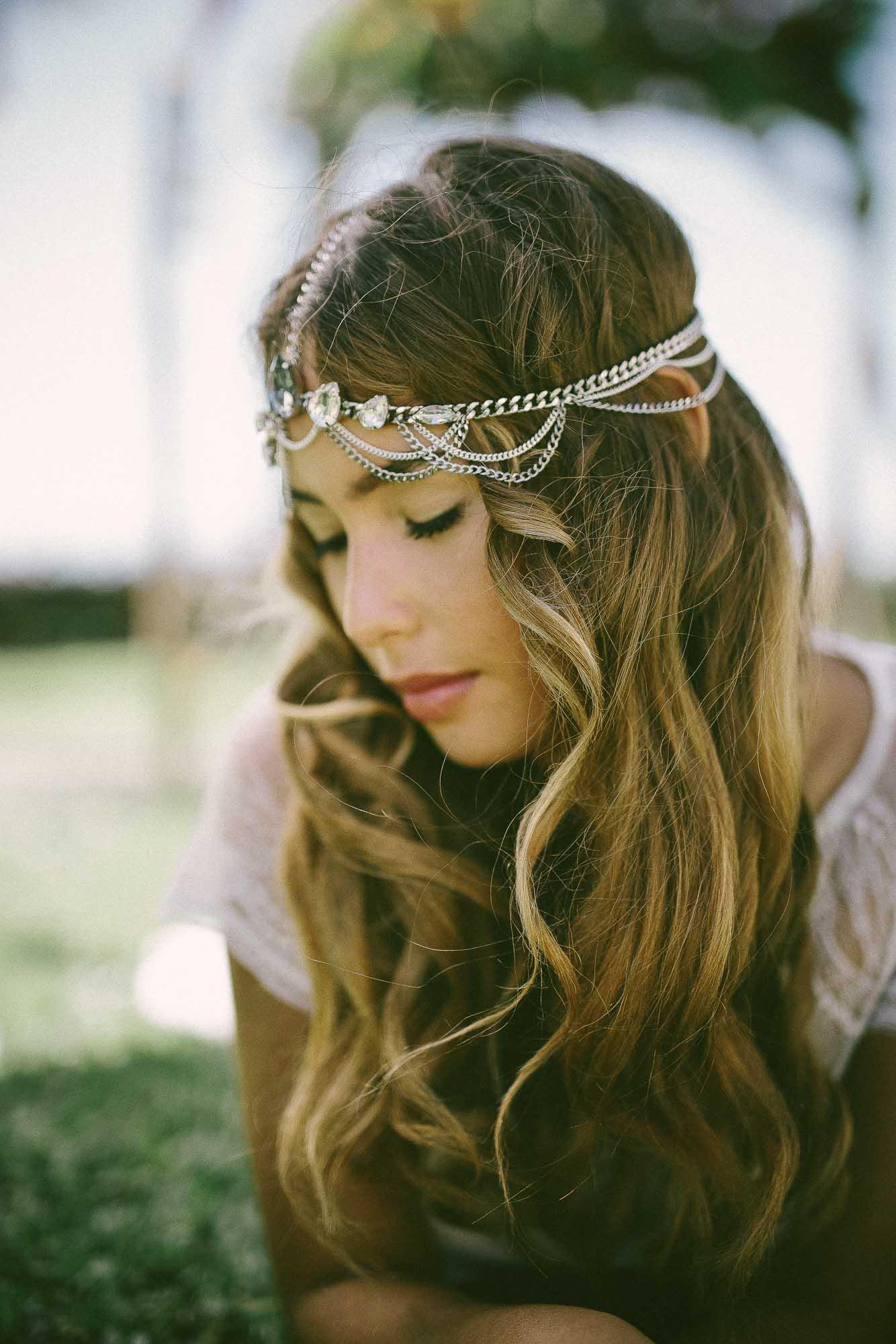 model lying in garden with headpiece by Frankly My Dear