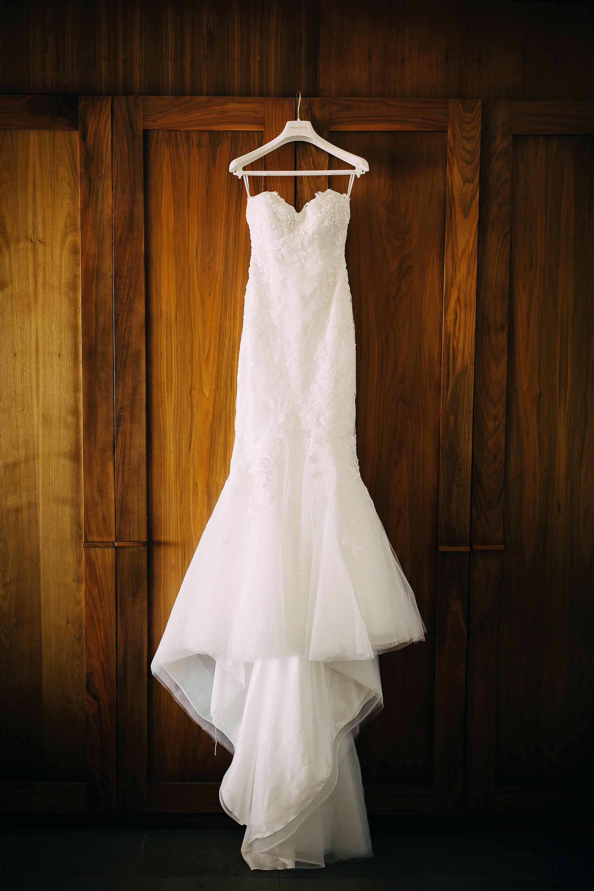 Fiji Bride's wedding dress hangs in her room waiting for the moment to shine.