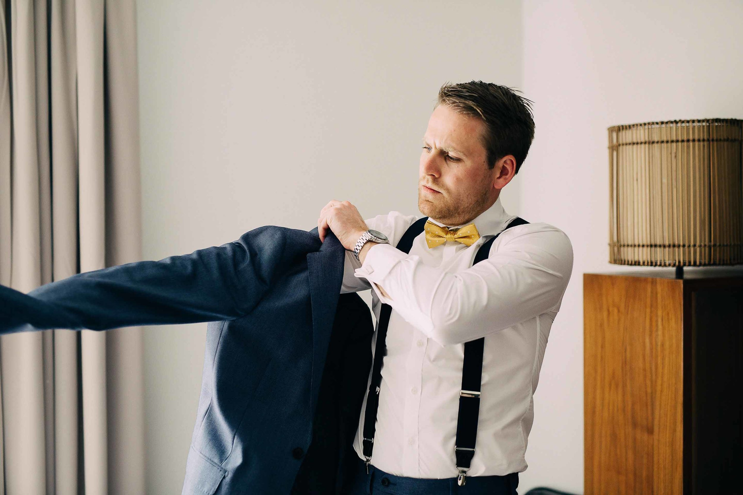 Fiji Groom puts on his suit ready to say I Do.