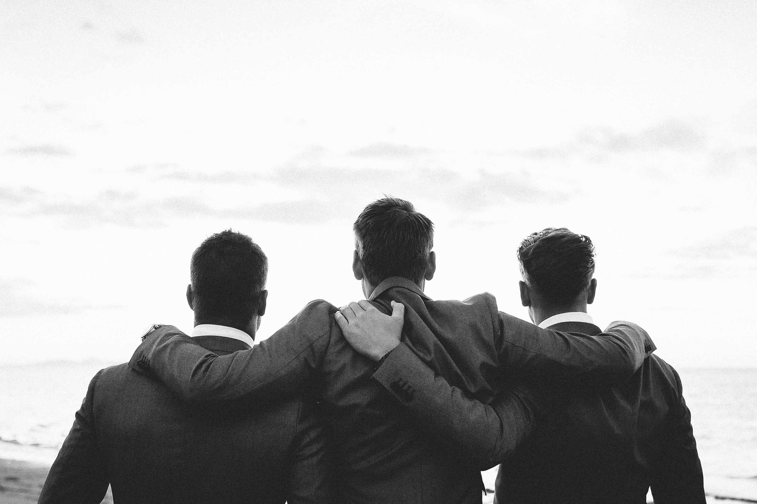 Fiji Groom and Groomsmen enjoy a friendly moment to take in the days emotions.