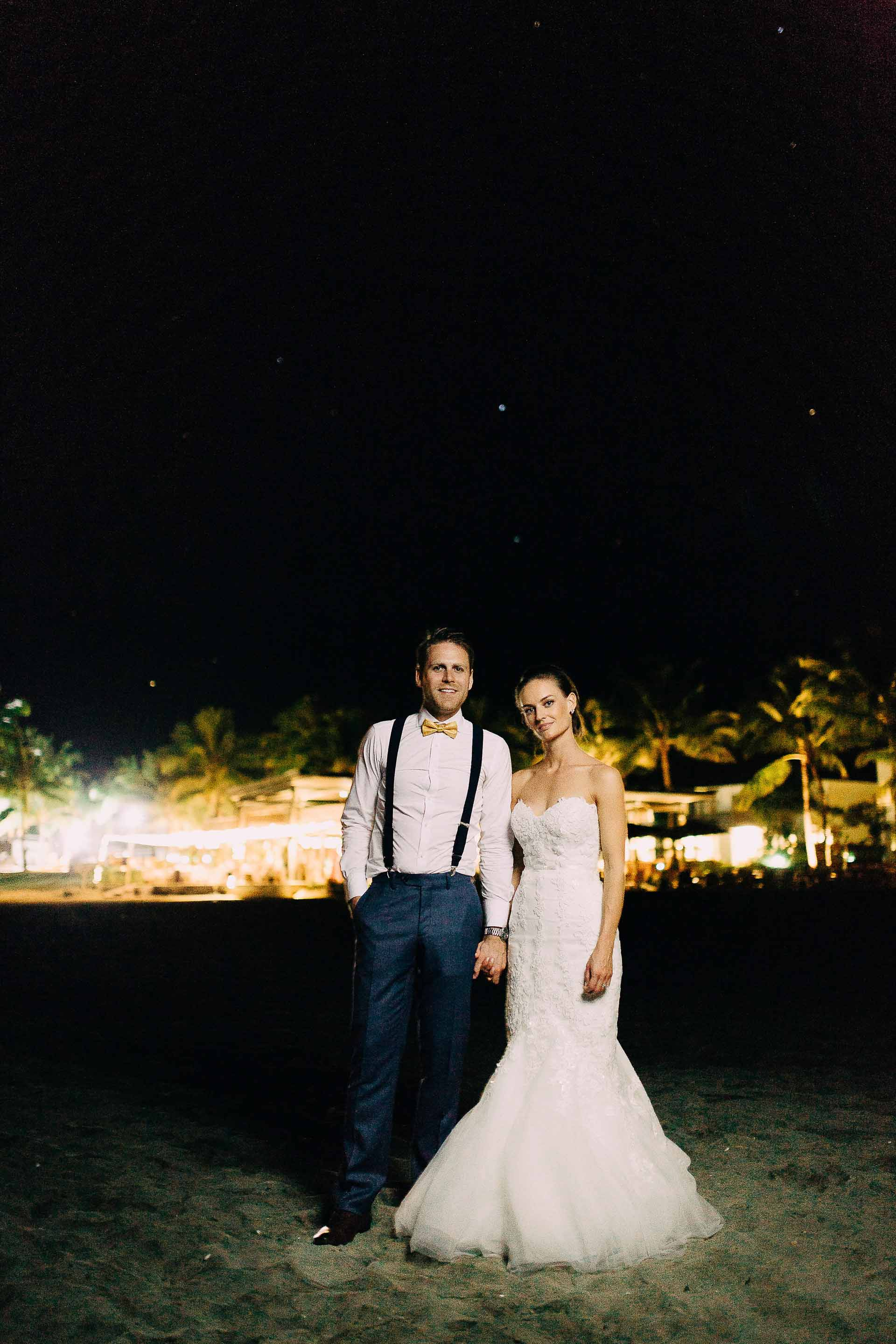 Fiji Bride & Groom in front of their reception lights on their wedding night.