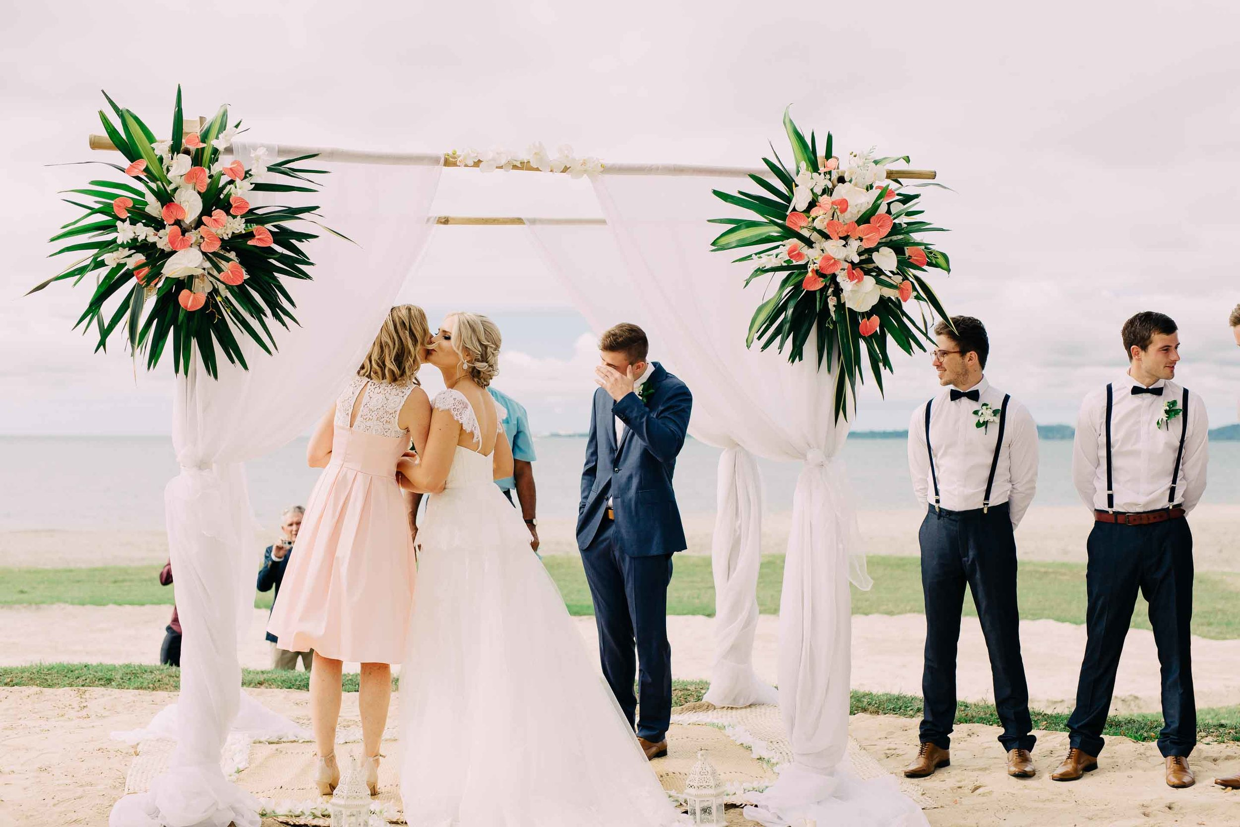 The groom cries as he sees his stunning bride for the first time. The bride kisses her mother before joining her husband to be under the ceremony arch.