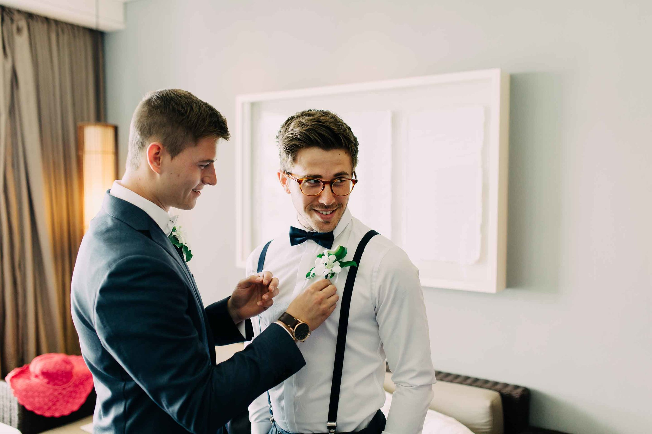 Groomsmen put on the final touches.