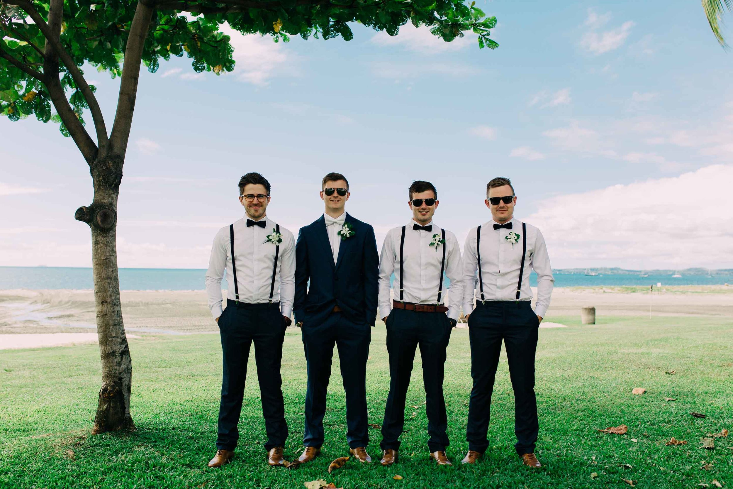 Stylish Groomsmen with Suspenders all ready for the Beach Ceremony at the Hilton Fiji.
