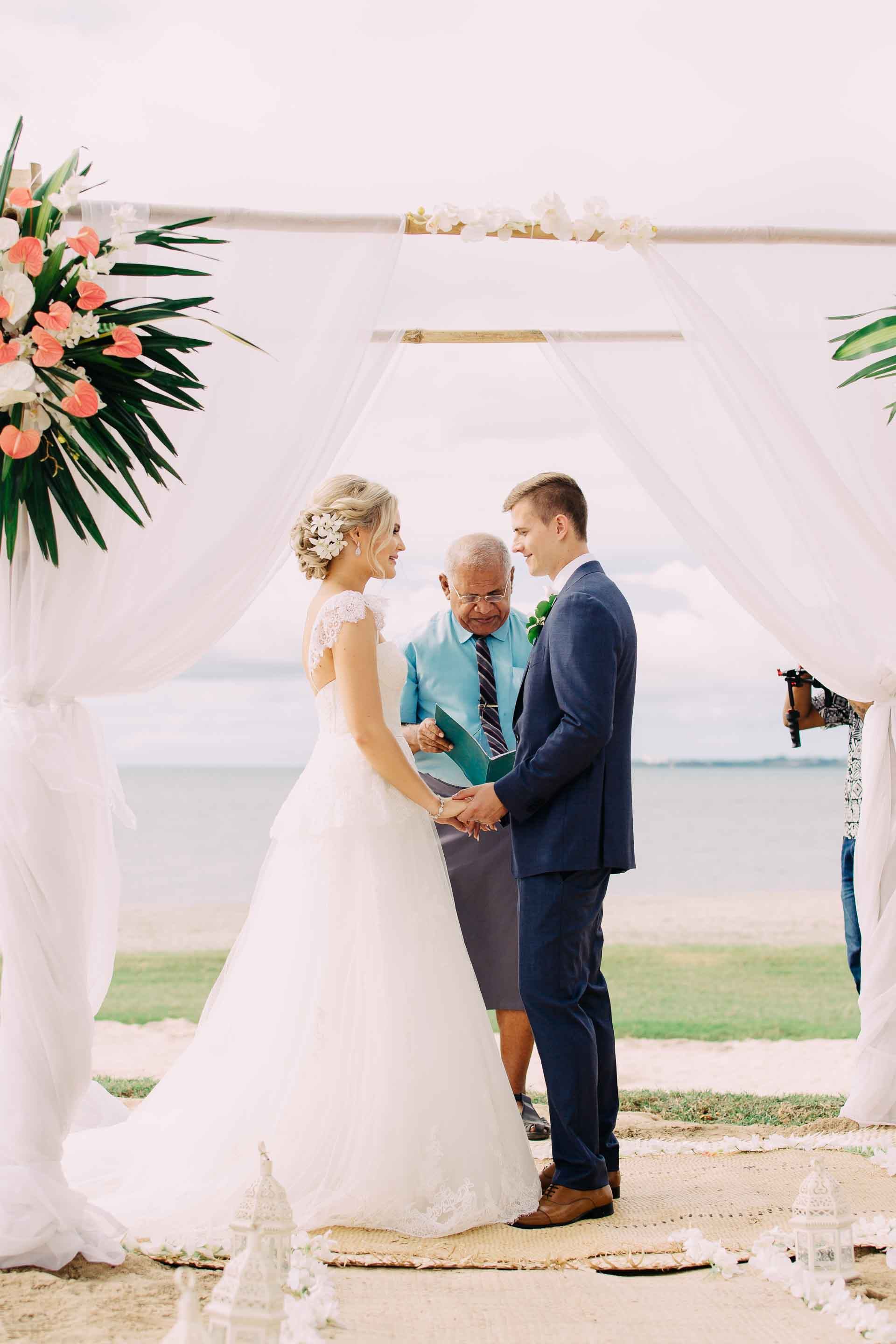Beautiful beach marriage ceremony with a celebrant to officiate the union.
