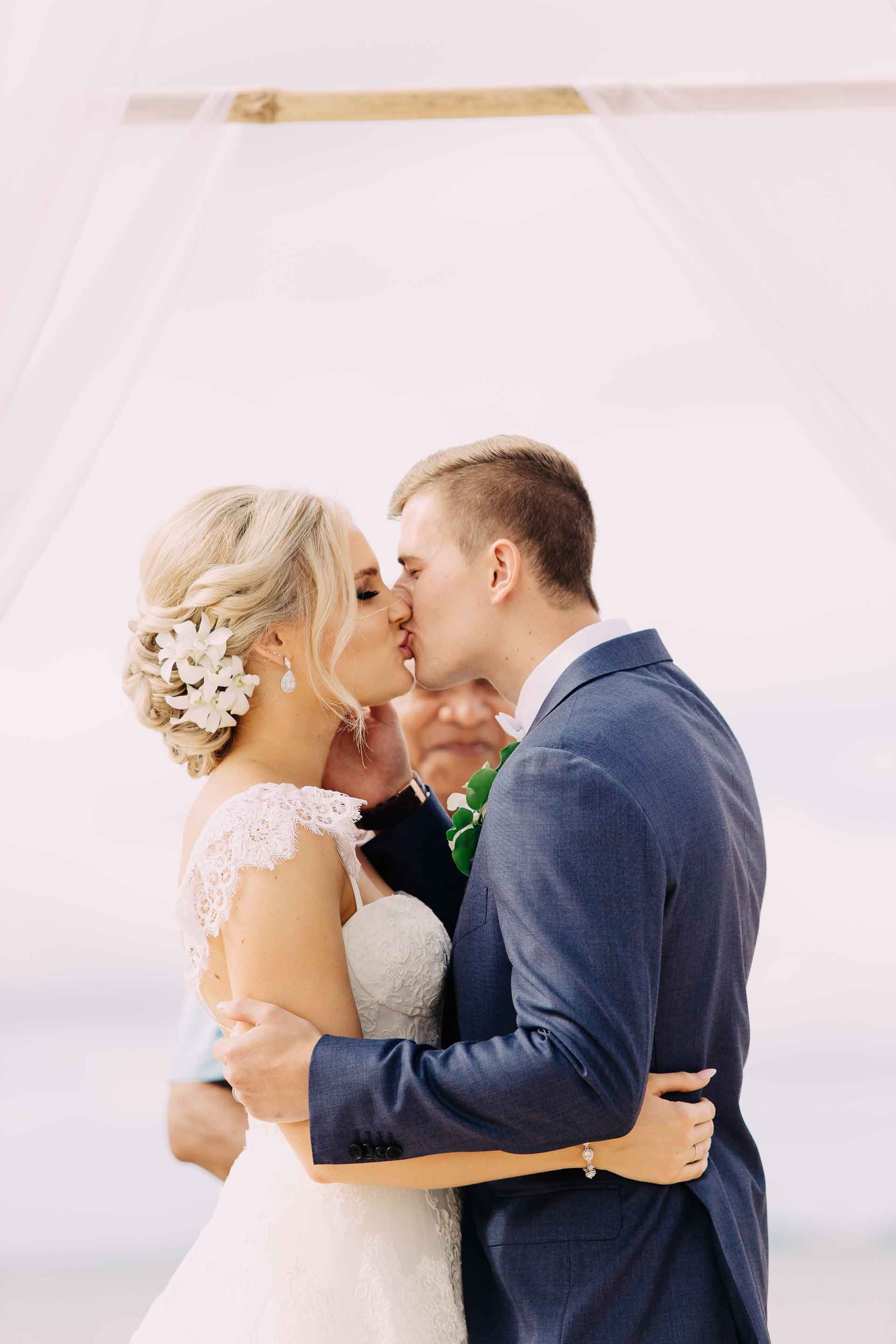The happy bride and groom have their First Kiss as husband and wife.