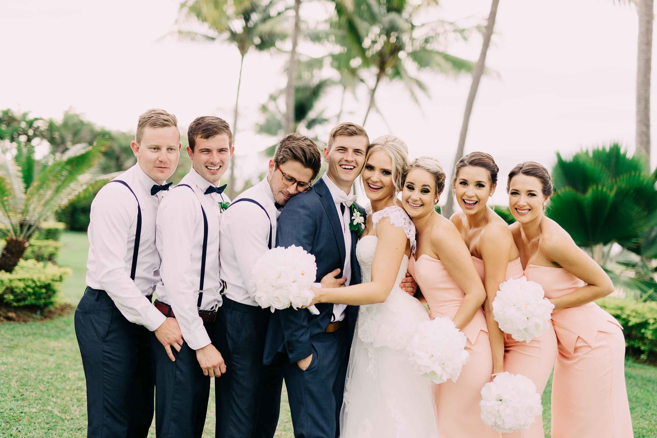 Stylish Bridal Party with white bouquets and coral coloured bridesmaids dresses.