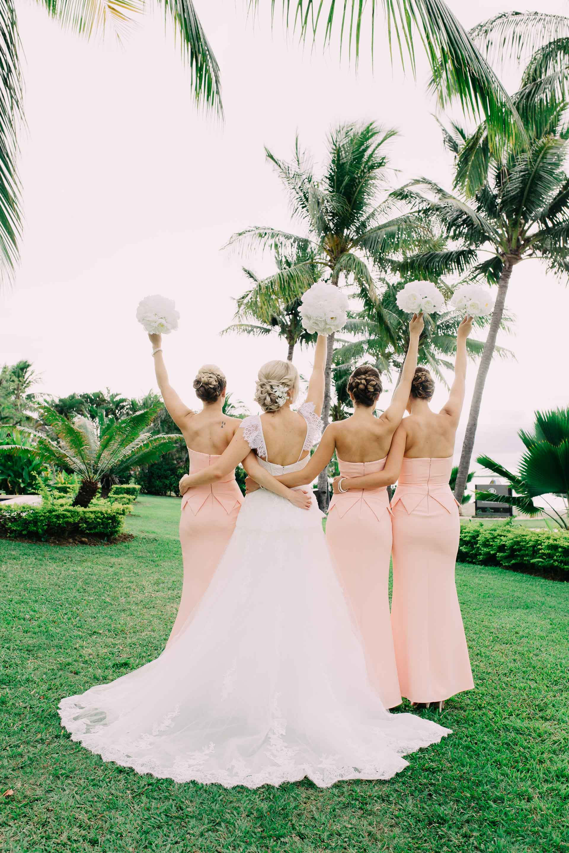 Bride with her Bridesmaids back shot with their white peony bouquets.