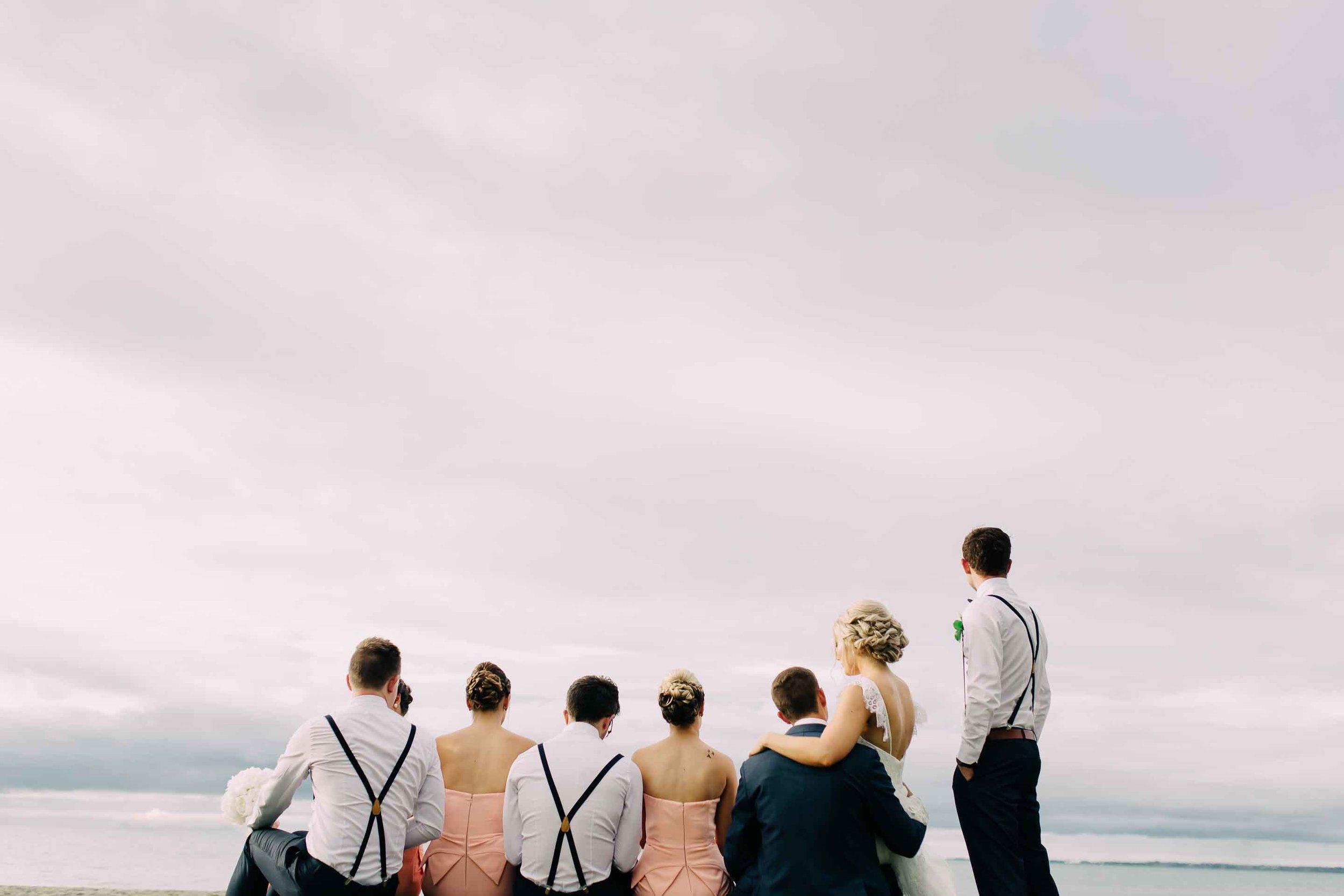 Bridal party admire the ocean vista at the Hilton Fiji.