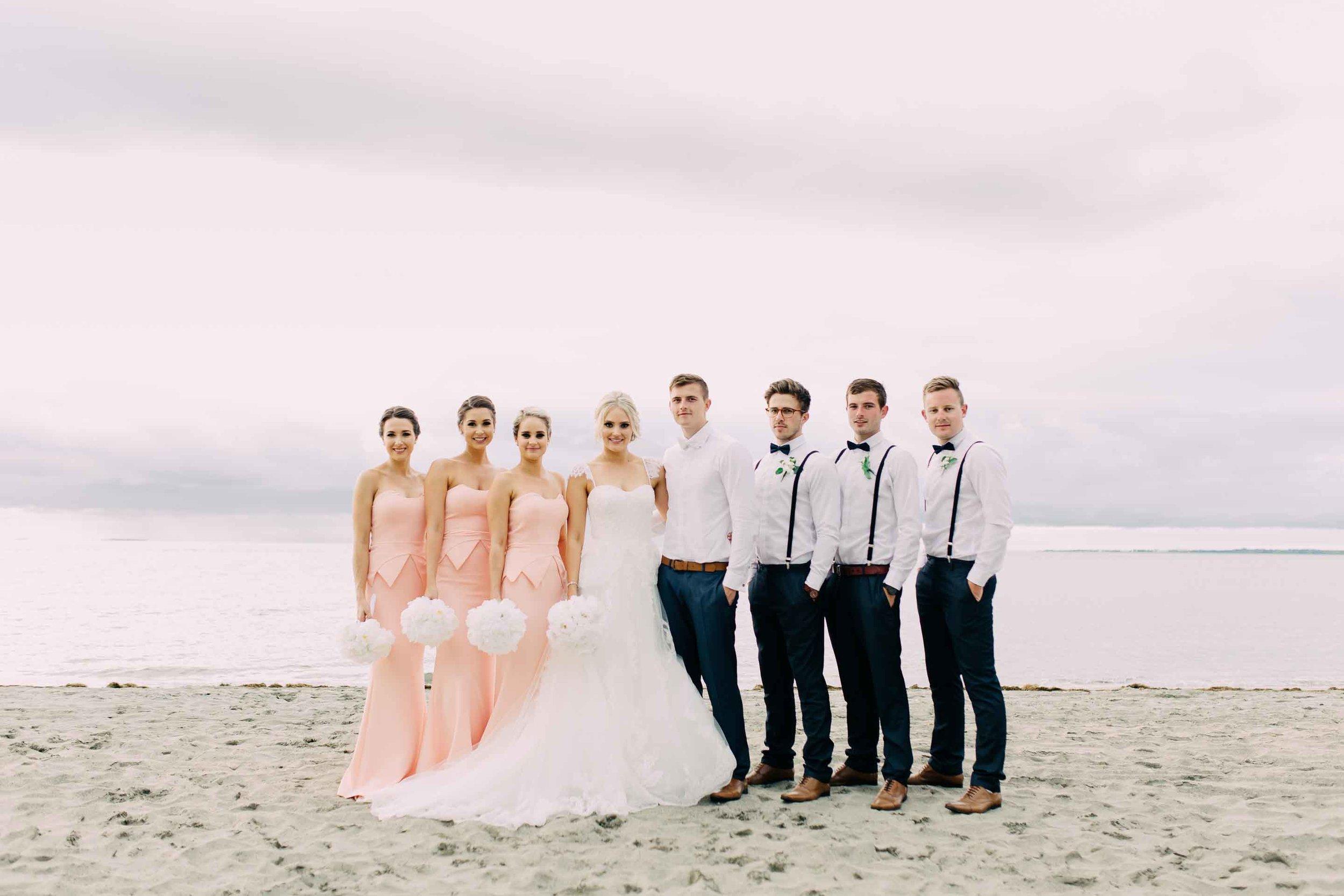Stylish Bridal Party on the beach Hilton Fiji.