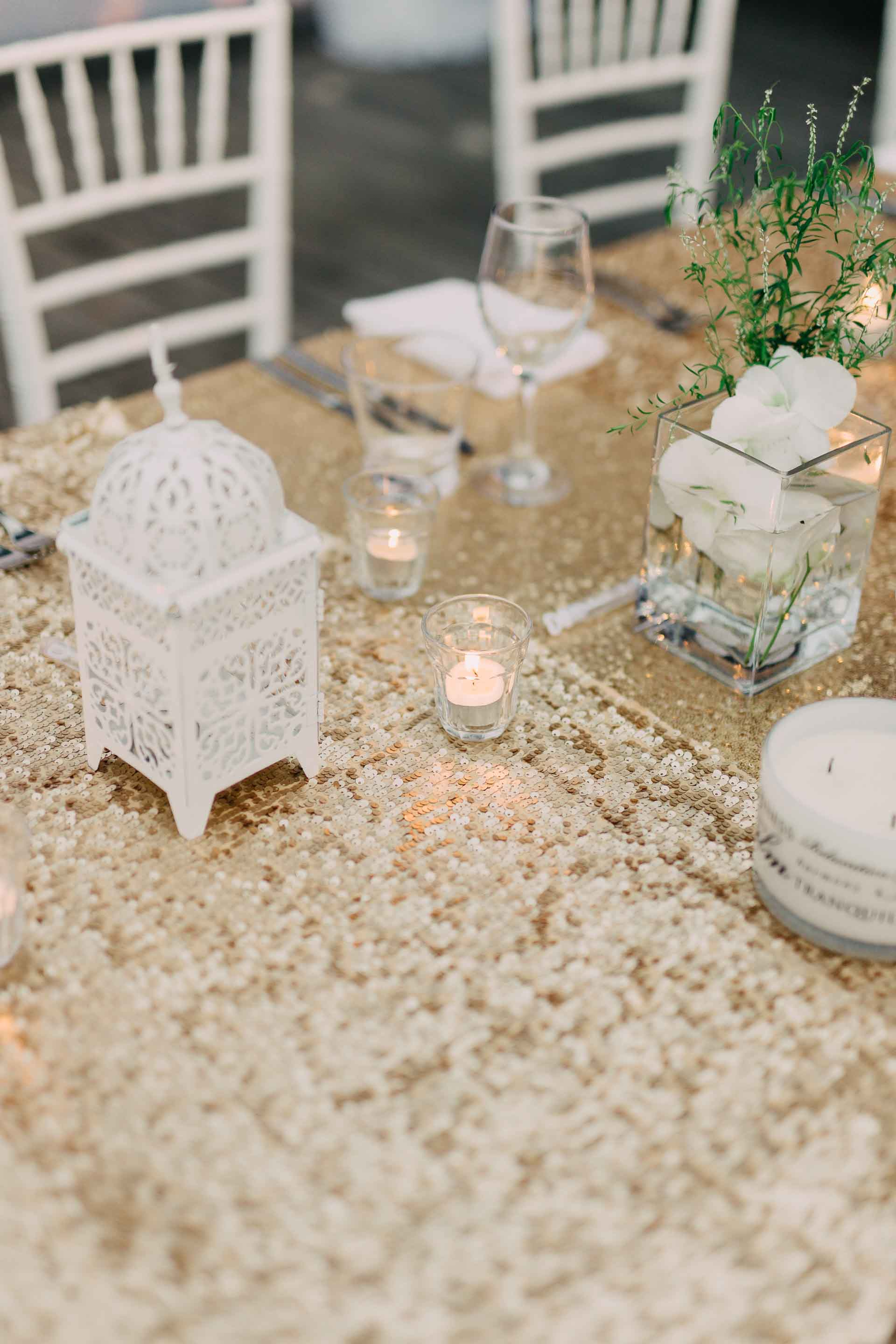 Beautiful white and golden themed Fiji wedding reception set up decorations decor at the Hilton