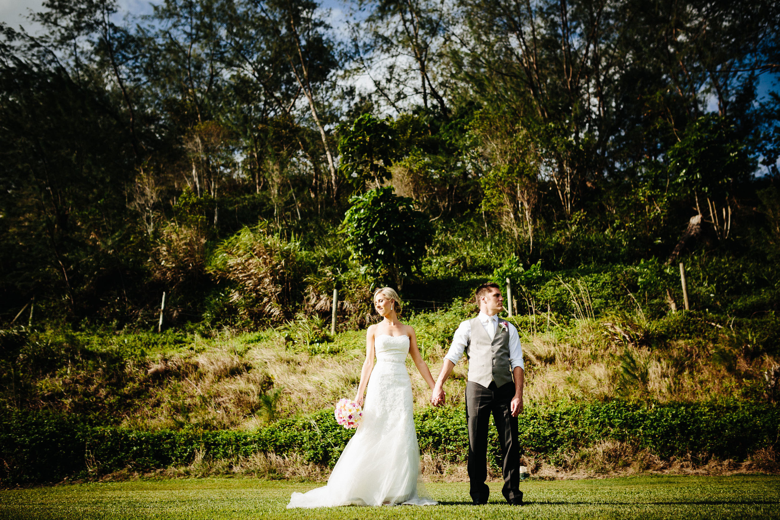 The newlyweds standing in a field