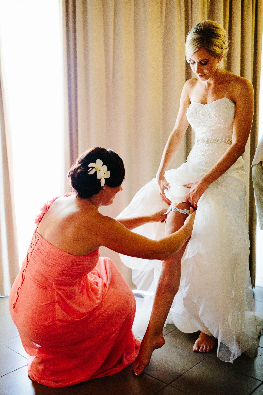 bride putting on garter belt
