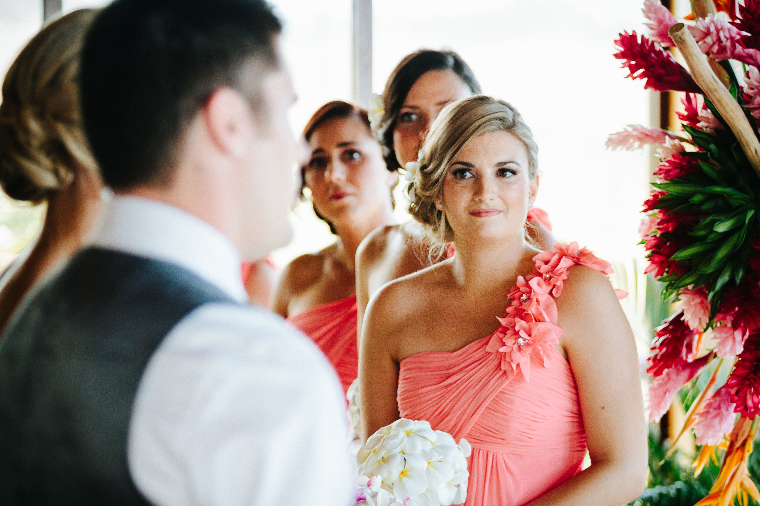 maid of honor watching the exchange of vows