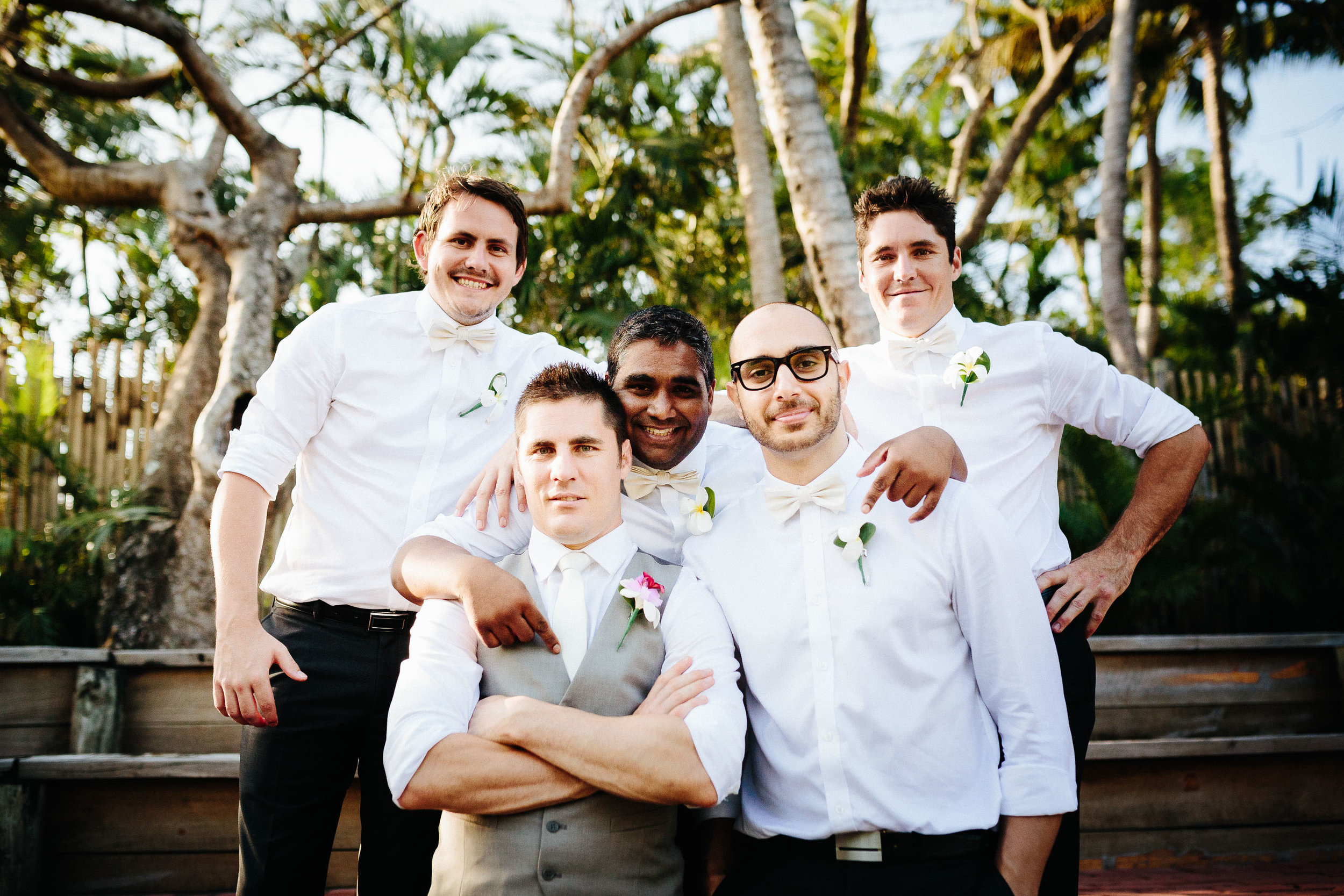 groom and groomsmen posing for a photo