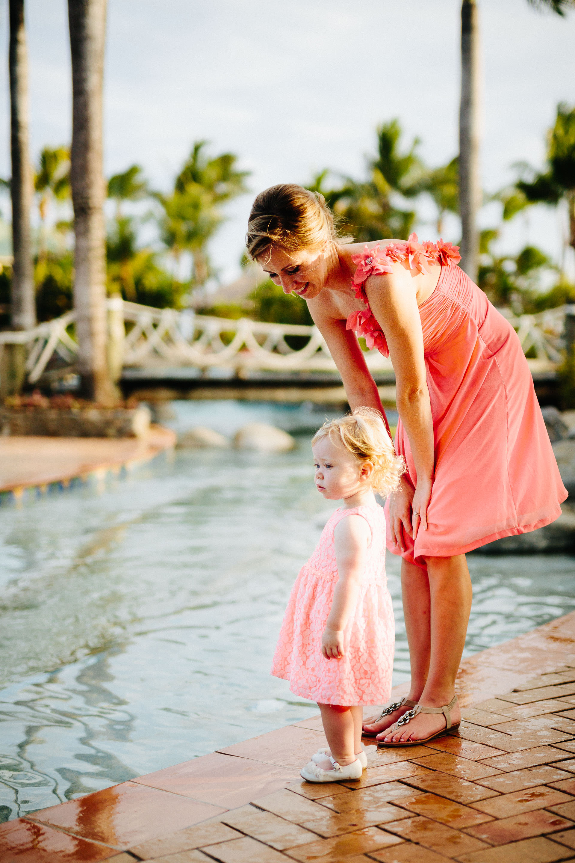 bridesmaid watching her daughter next to the pool