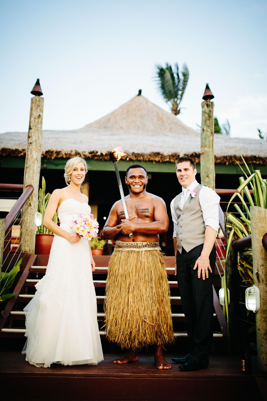 bride and groom with Fijian warrior