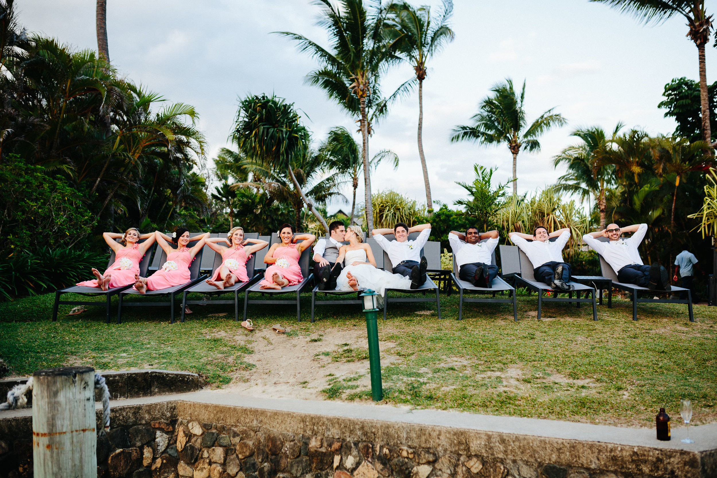 bridal party resting on sun beds