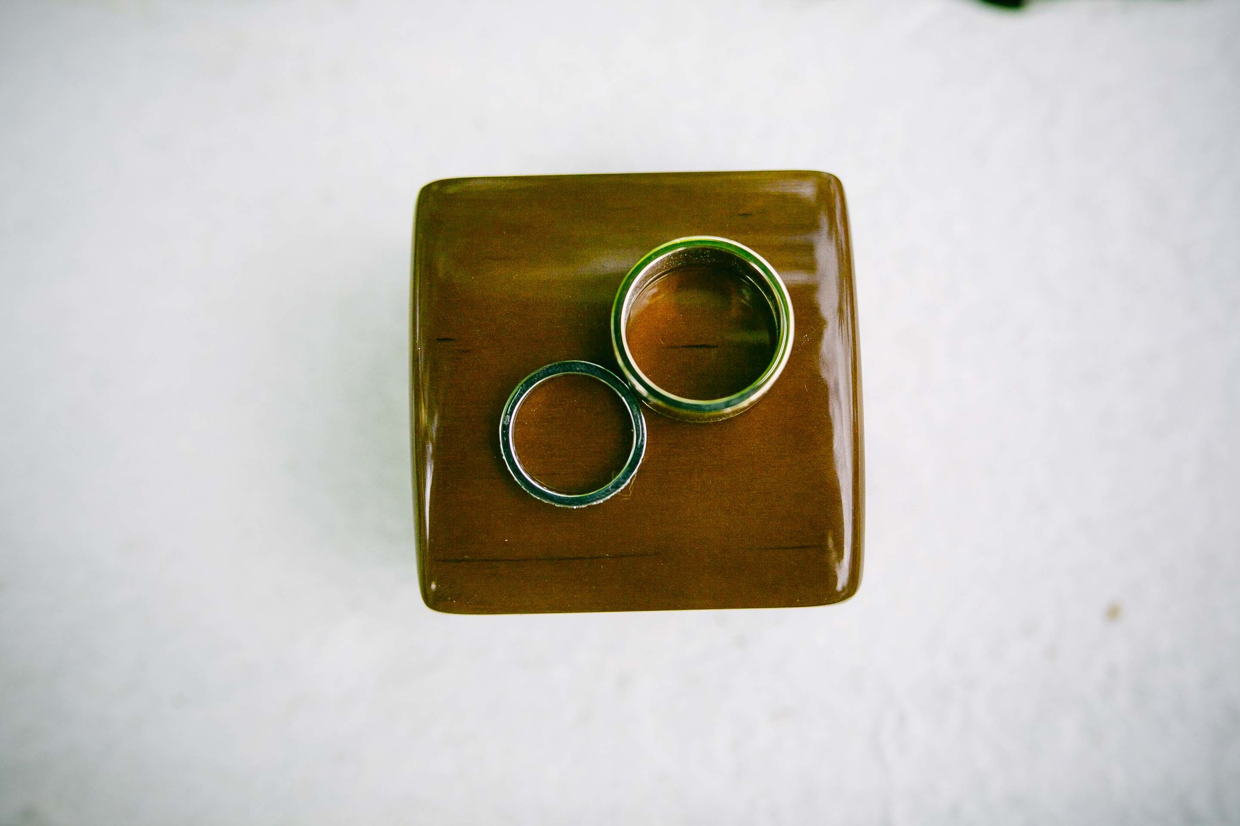 The wedding rings on their box