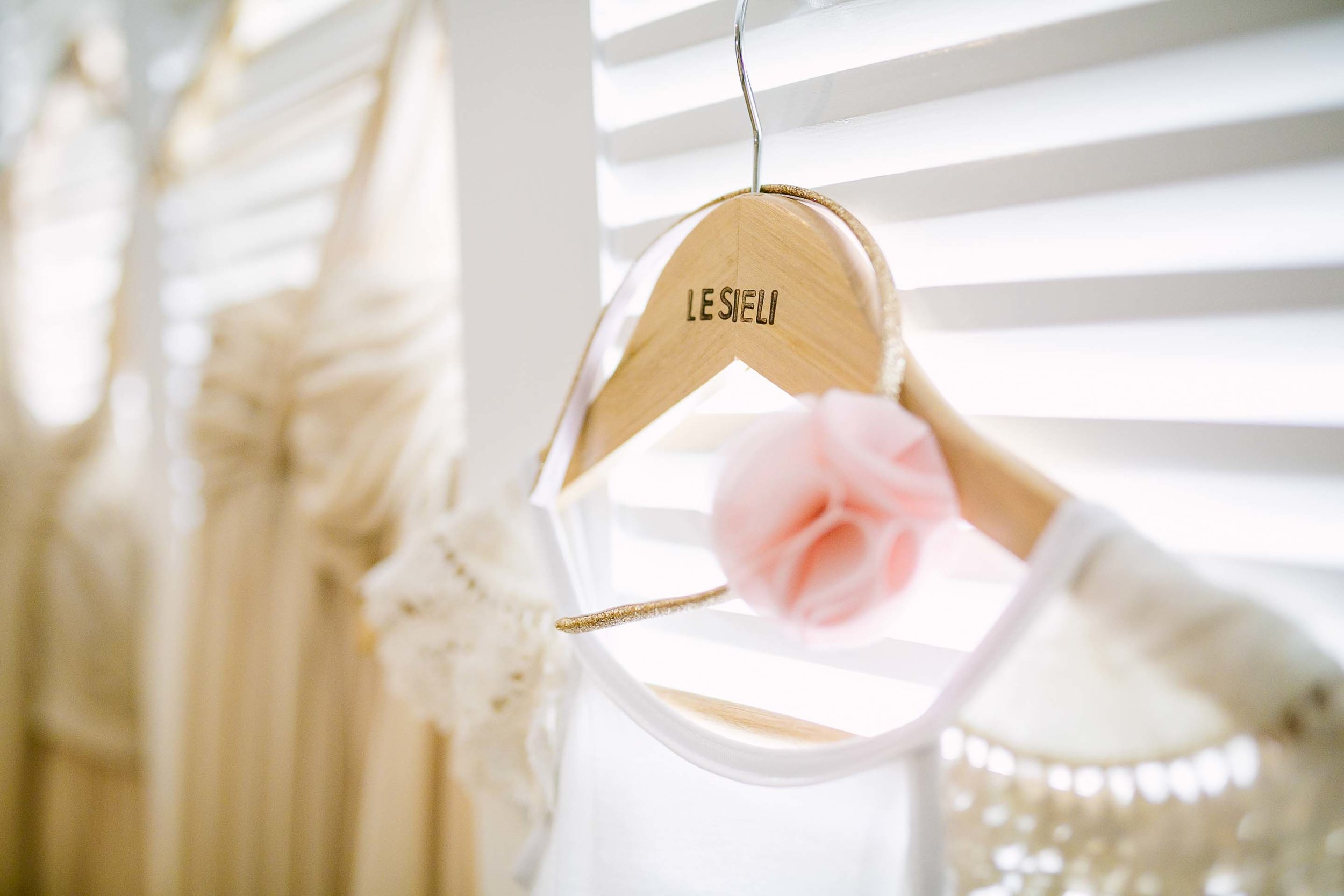 custom clothes hanger for the bride and bridesmaids dresess