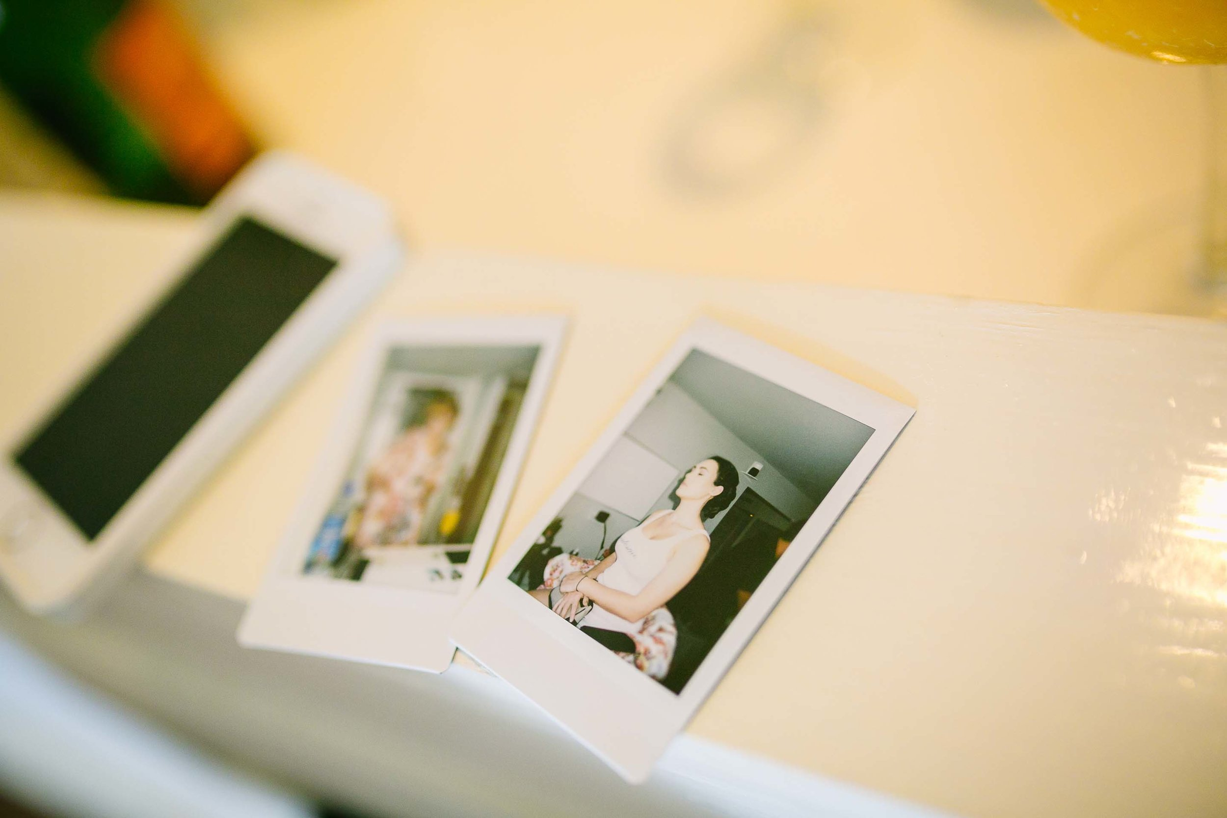 polaroid photos taken by the bridesmaids as they get ready