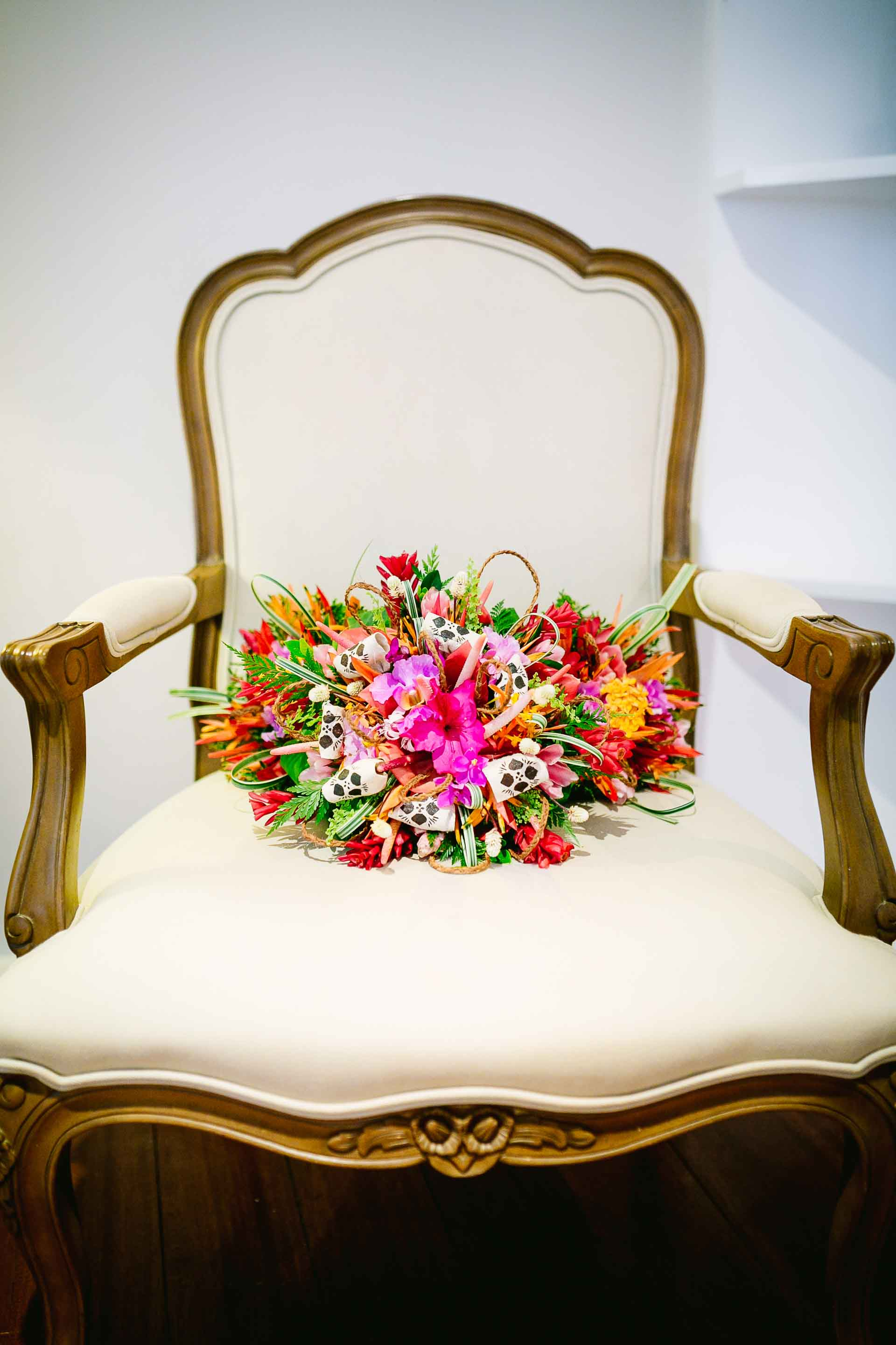 bridal bouquet placed on an antique chair