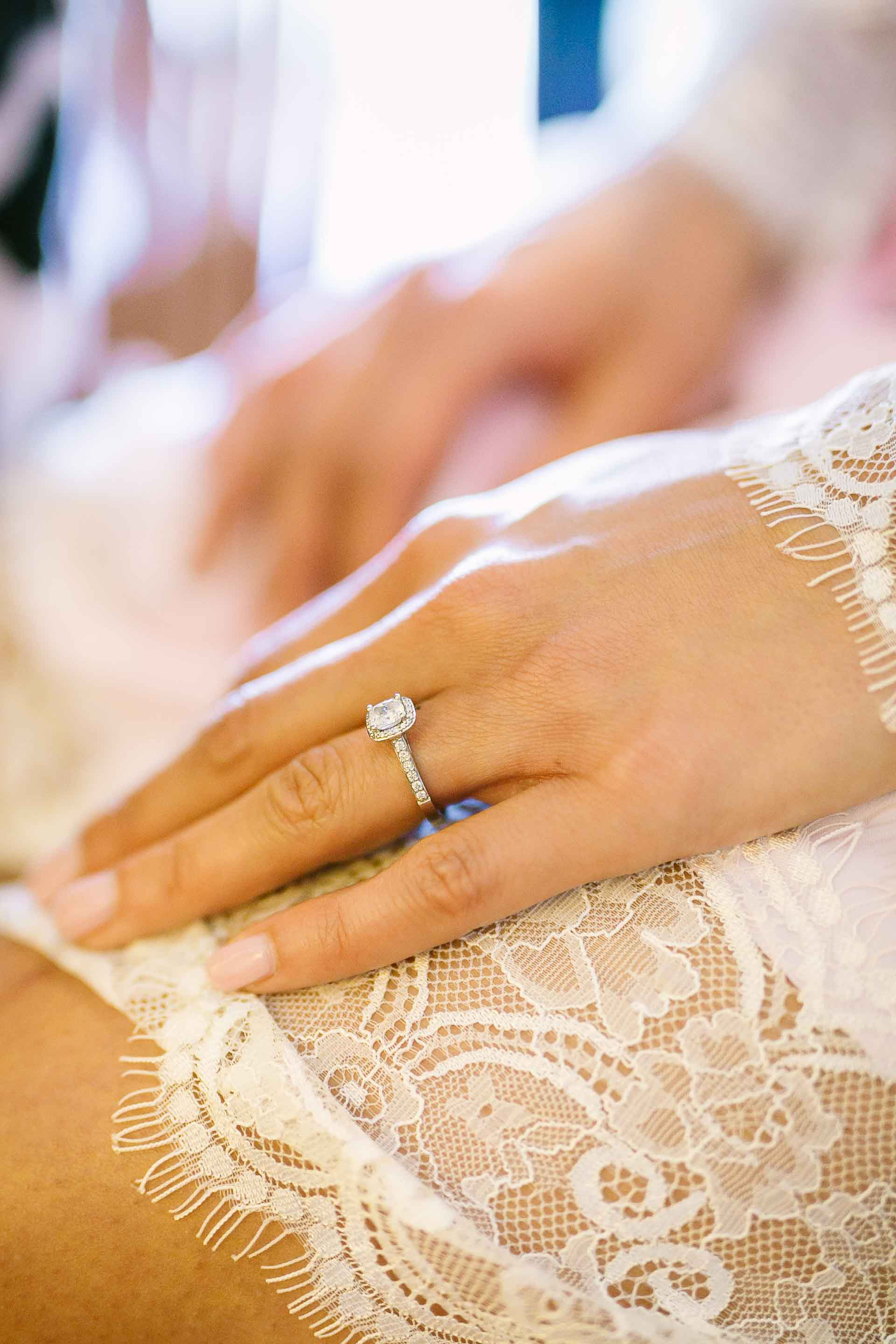 bride resting her hand on her thigh as she has her makeup done