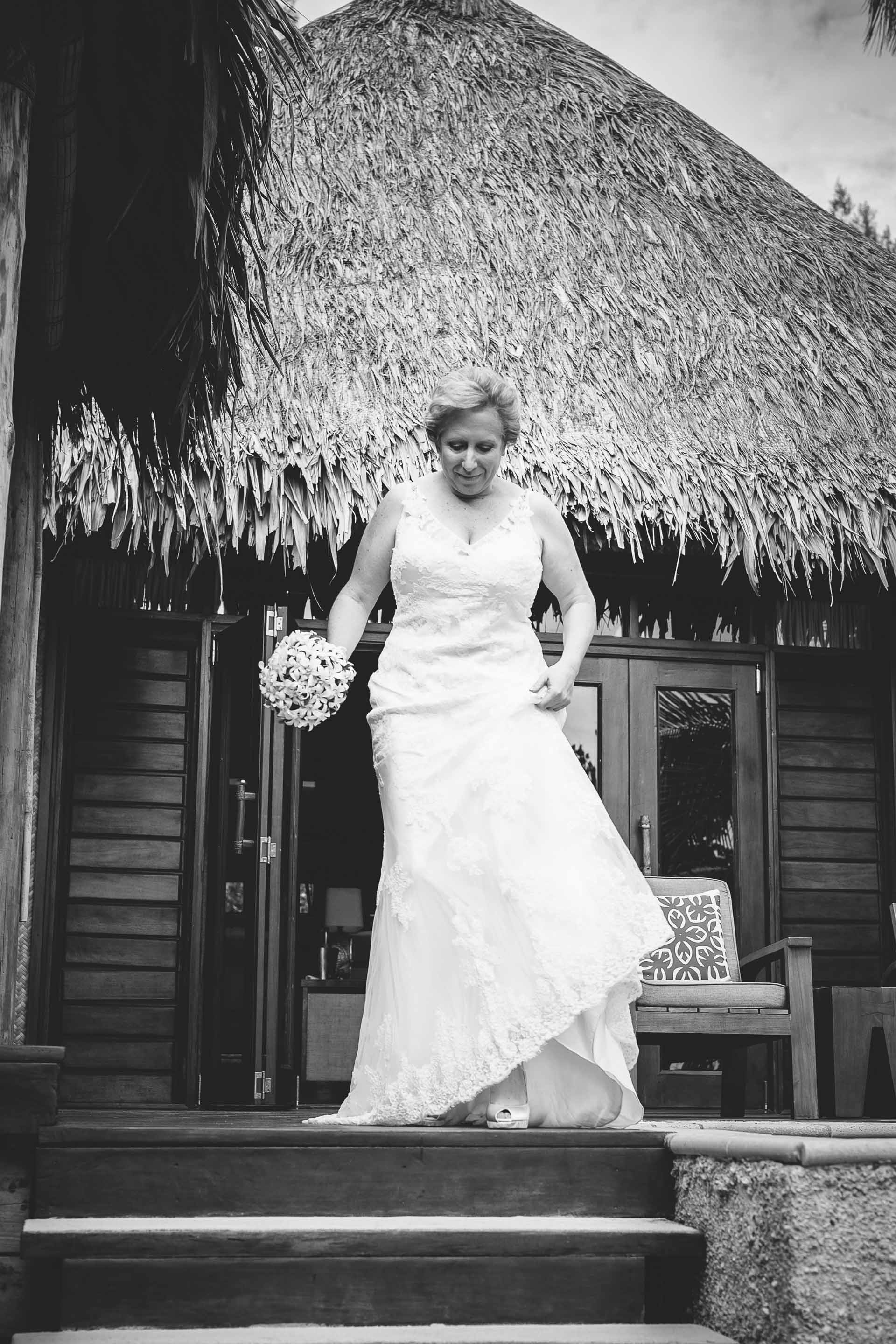 bride leaving her room to walk down the asile