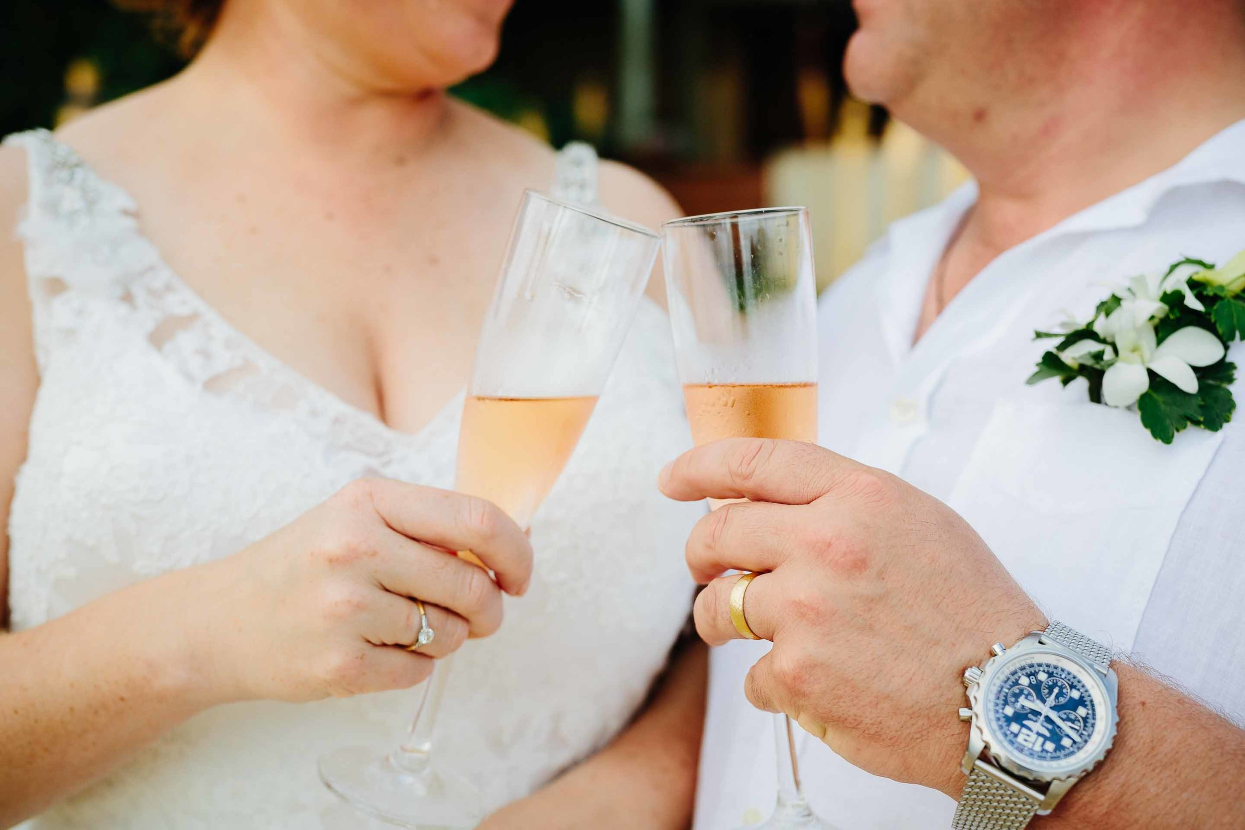 cheers. the couple enjoying a glass of champagne