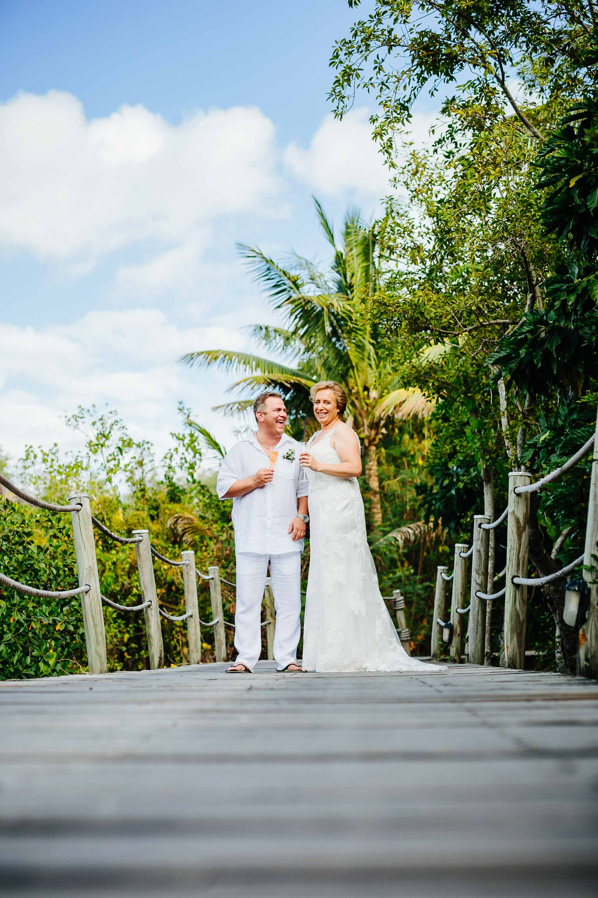 the couple on the pier over the mangroves