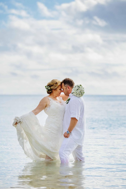 Newlyweds in knee-deep water