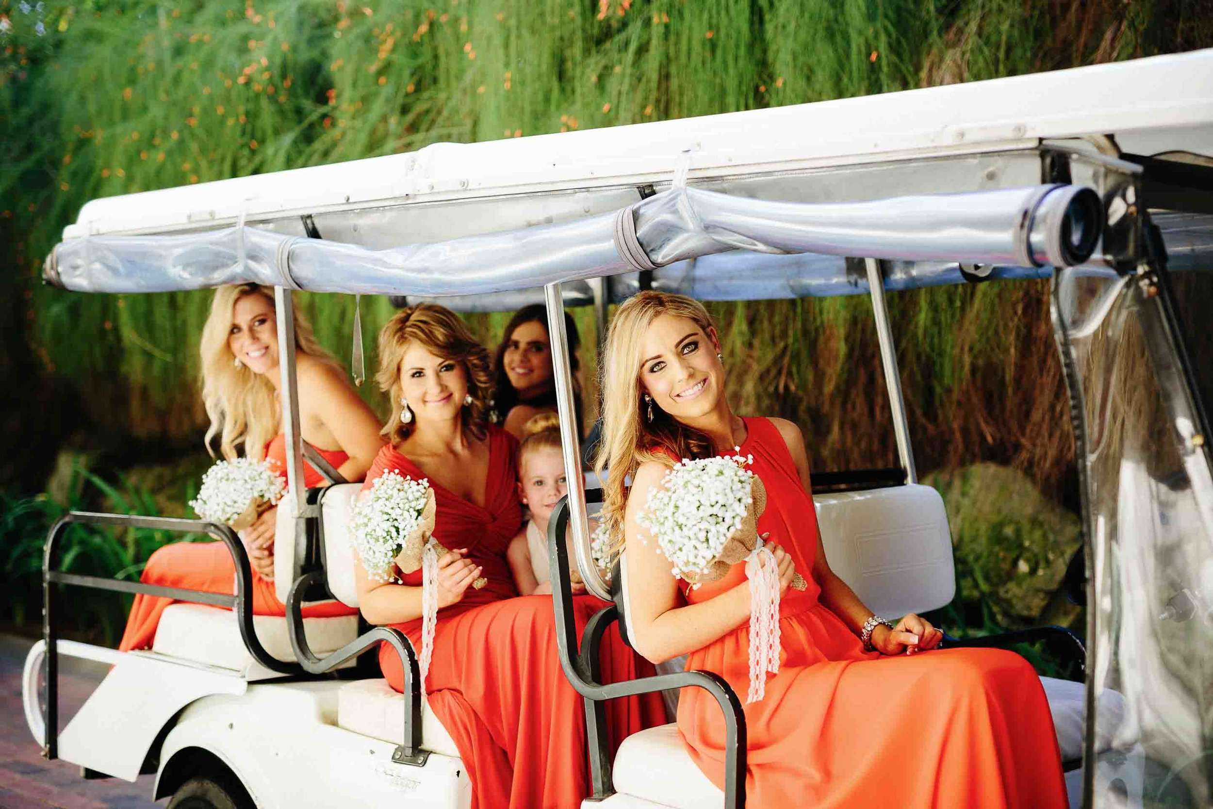bridesmaids in the buggy leaving for the chapel
