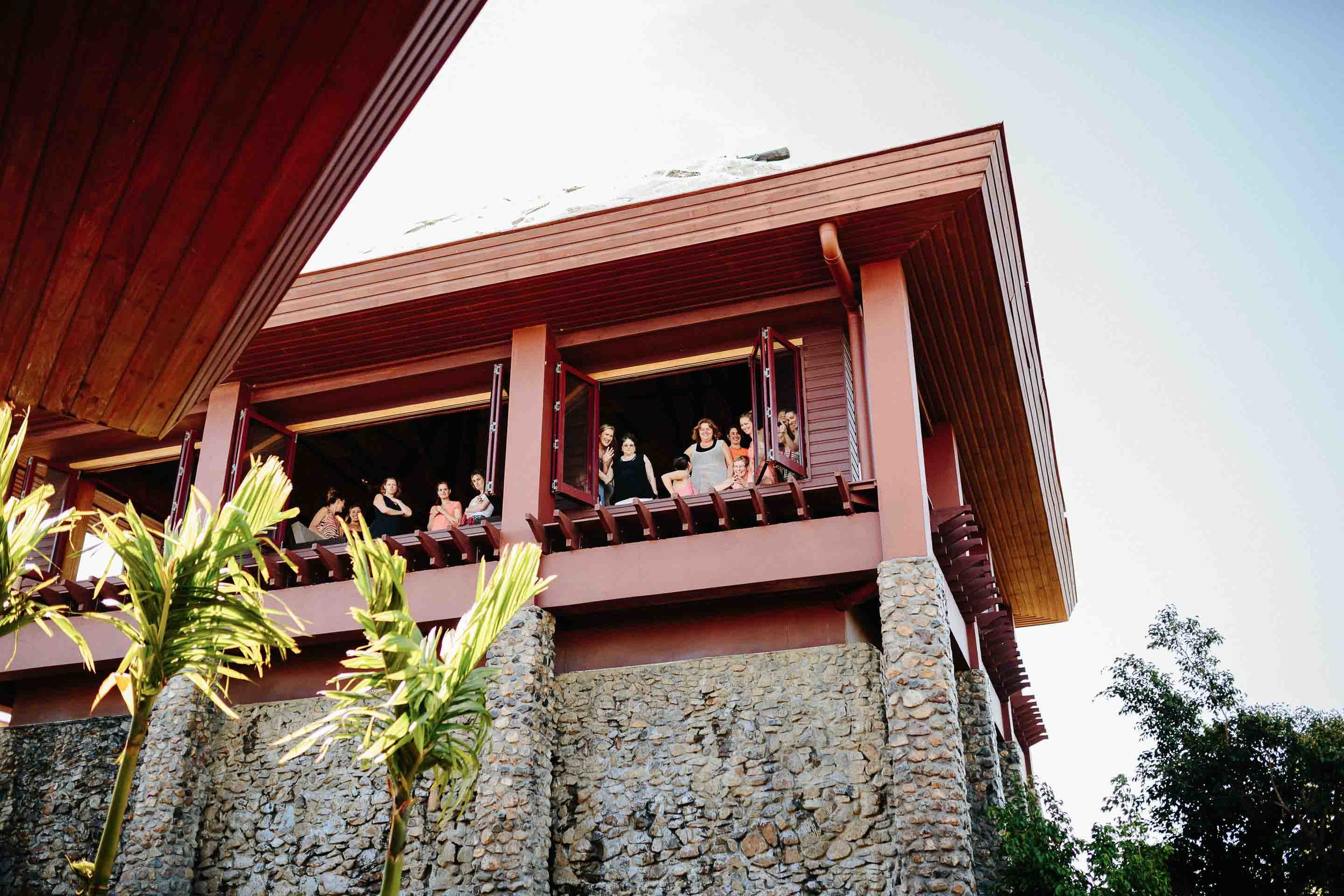 Guests of the Kalokalo Hilltop Bar watching the brides entrance